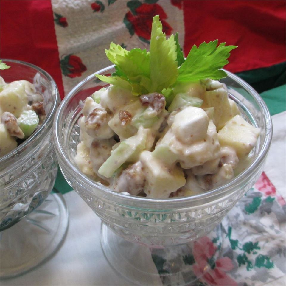 individual serving of Date-Marshmallow Waldorf Salad recipe with apples, celery, date, walnuts, and mini-marshmallows in creamy dressing