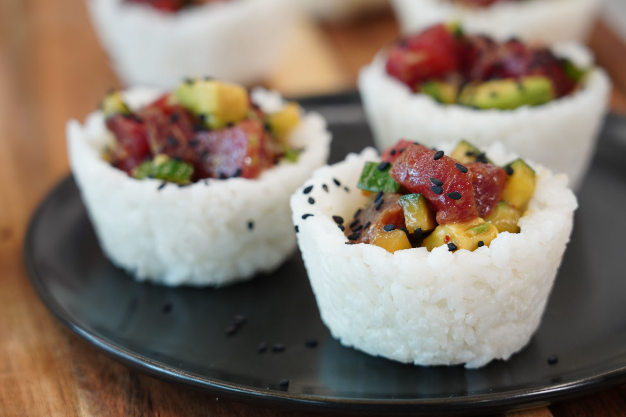 three portions of rice cups filled with ahi tuna sushi recipe on a plate