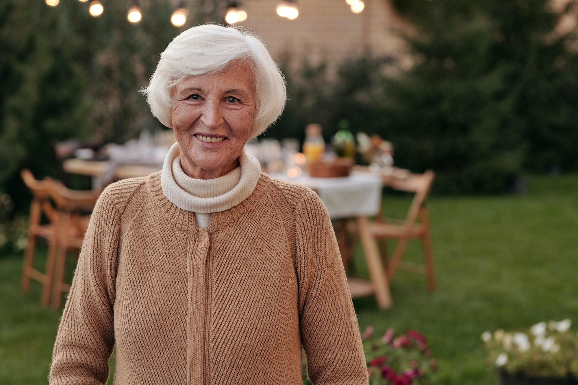 grandmother standing in front of outdoor dining table