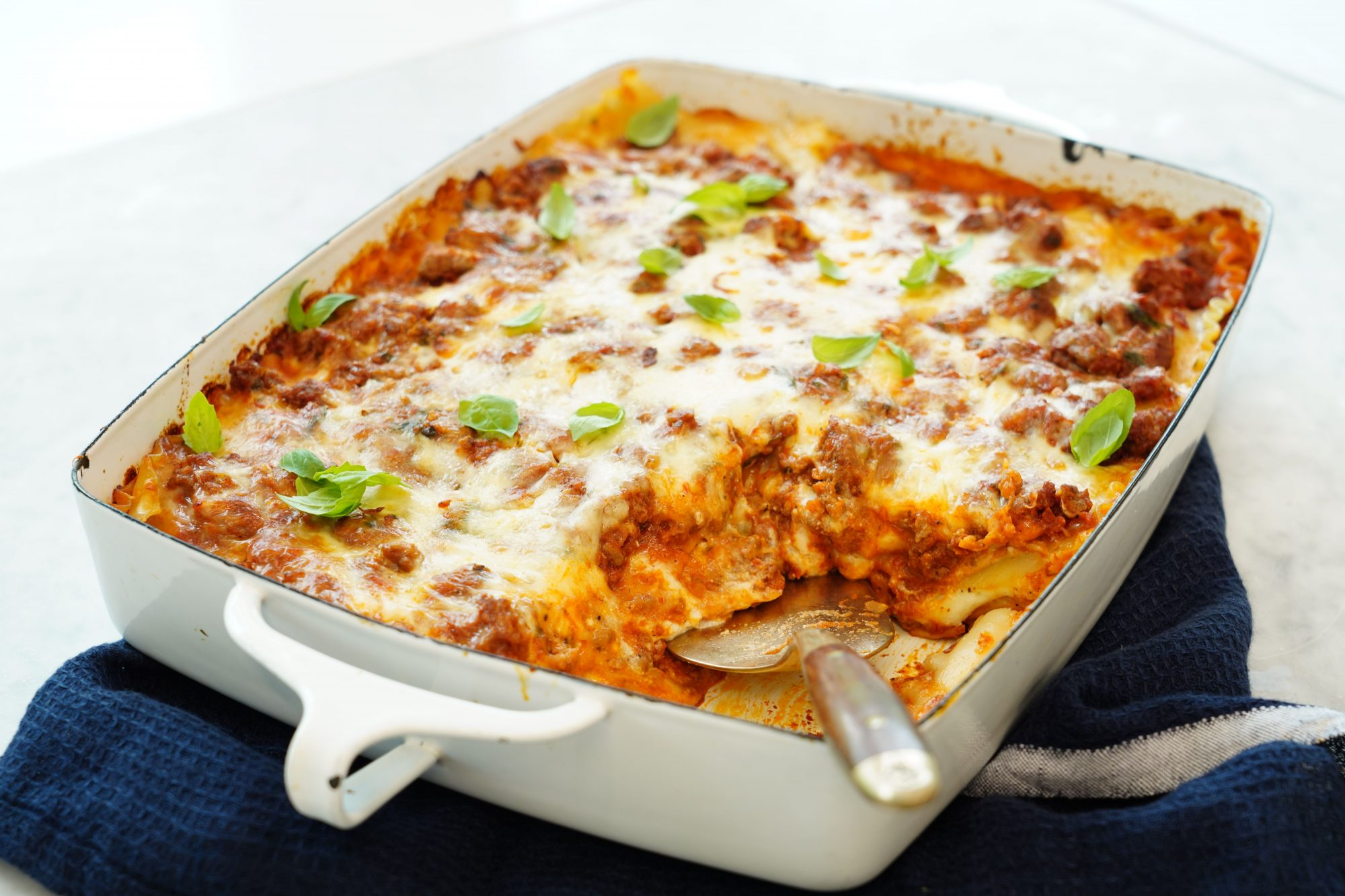 homemade baked lasagna with ricotta bechamel sauce in a casserole dish