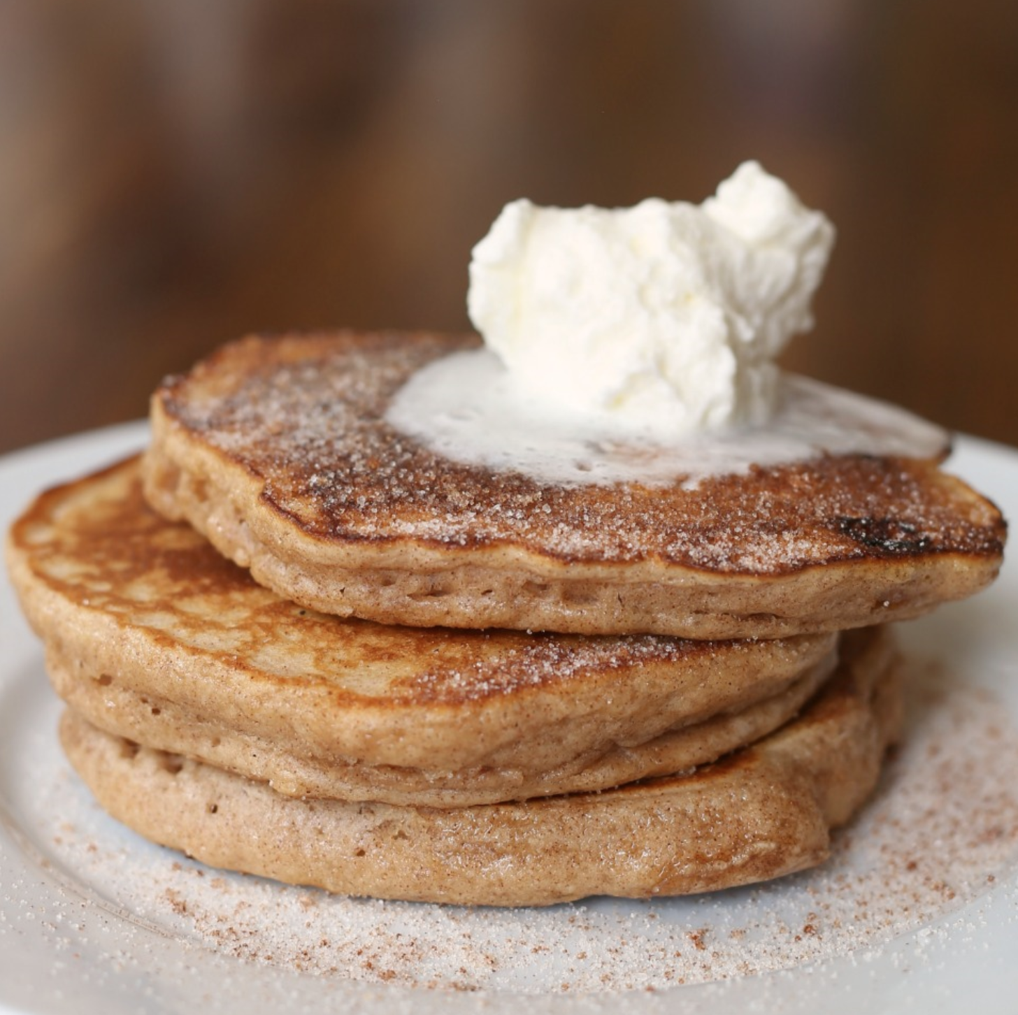 Snickerdoodle Pancakes on a white plate