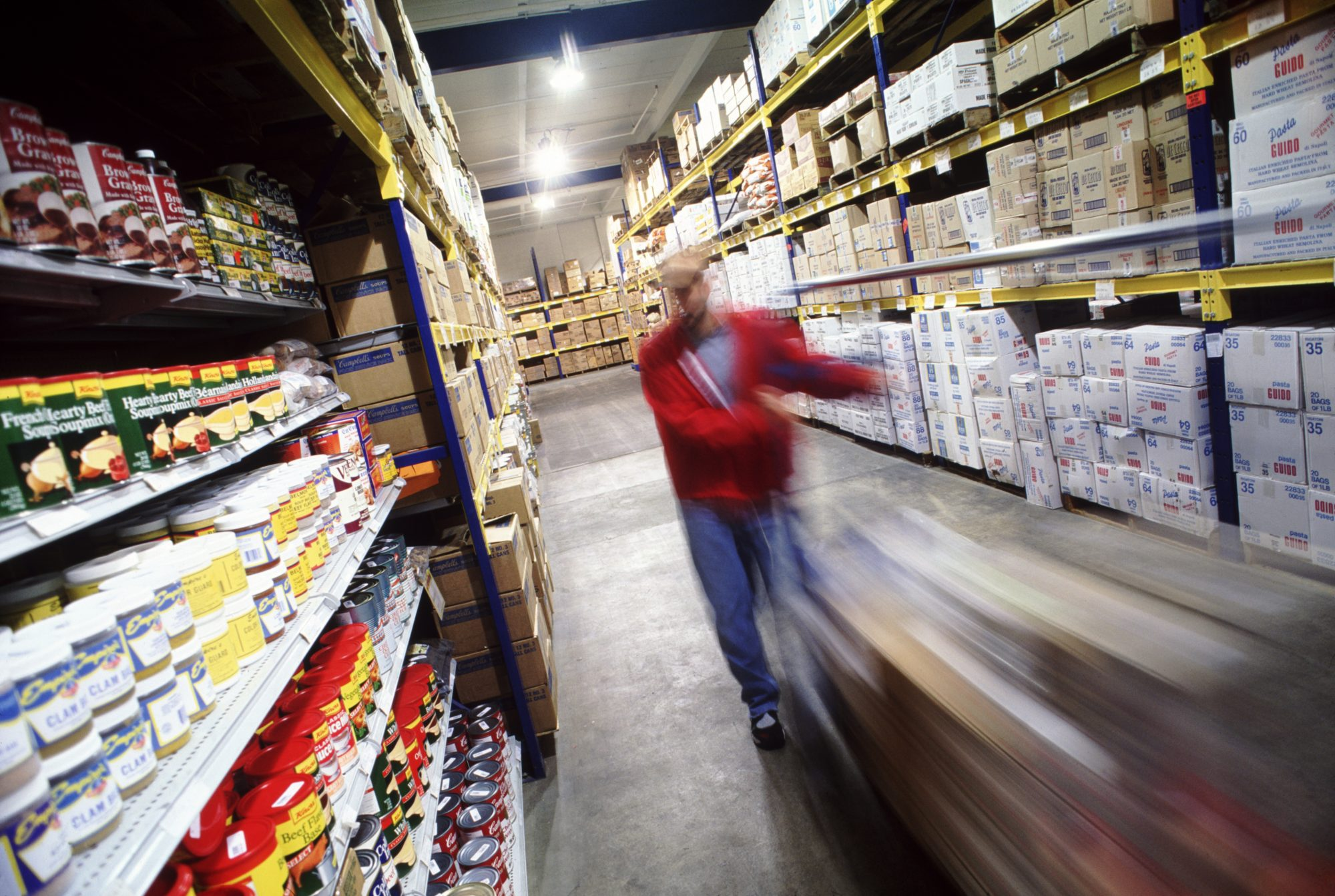 blurry store employee moving down an aisle
