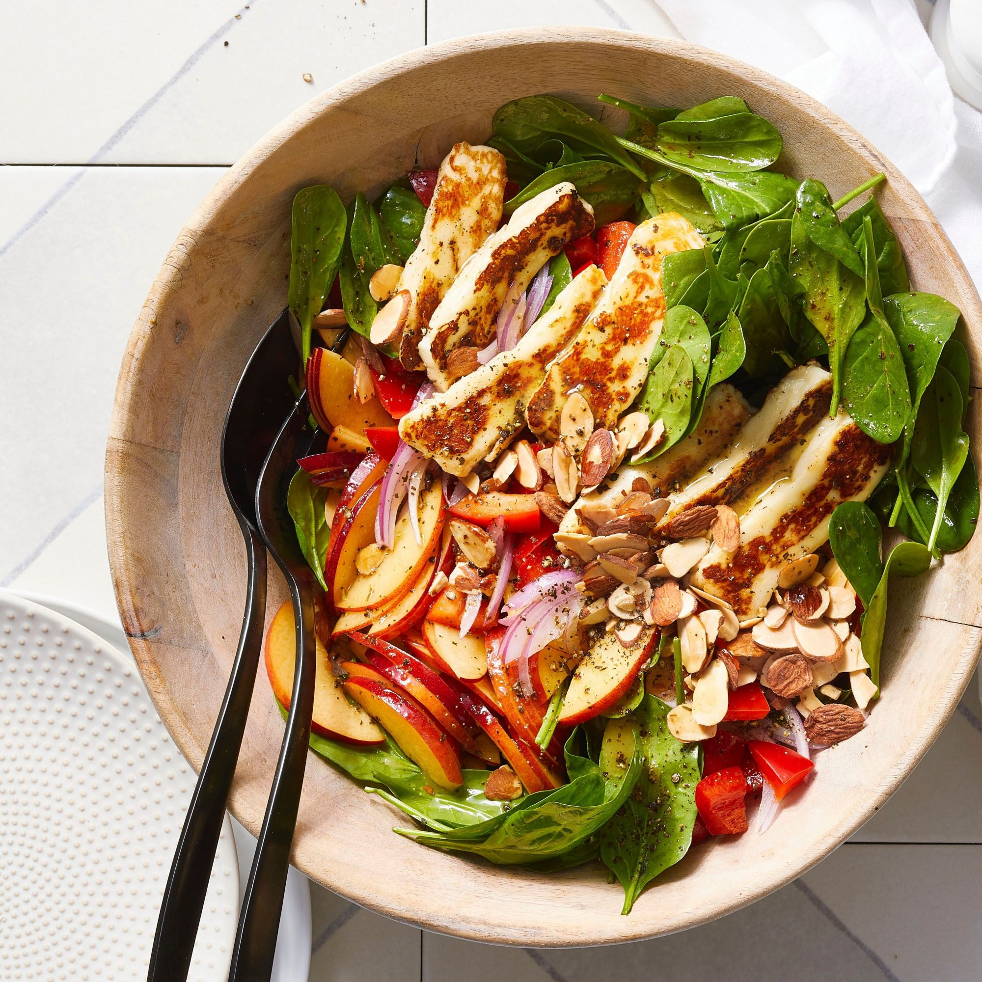 overhead view of Spinach, Nectarine, and Halloumi Salad in a bowl