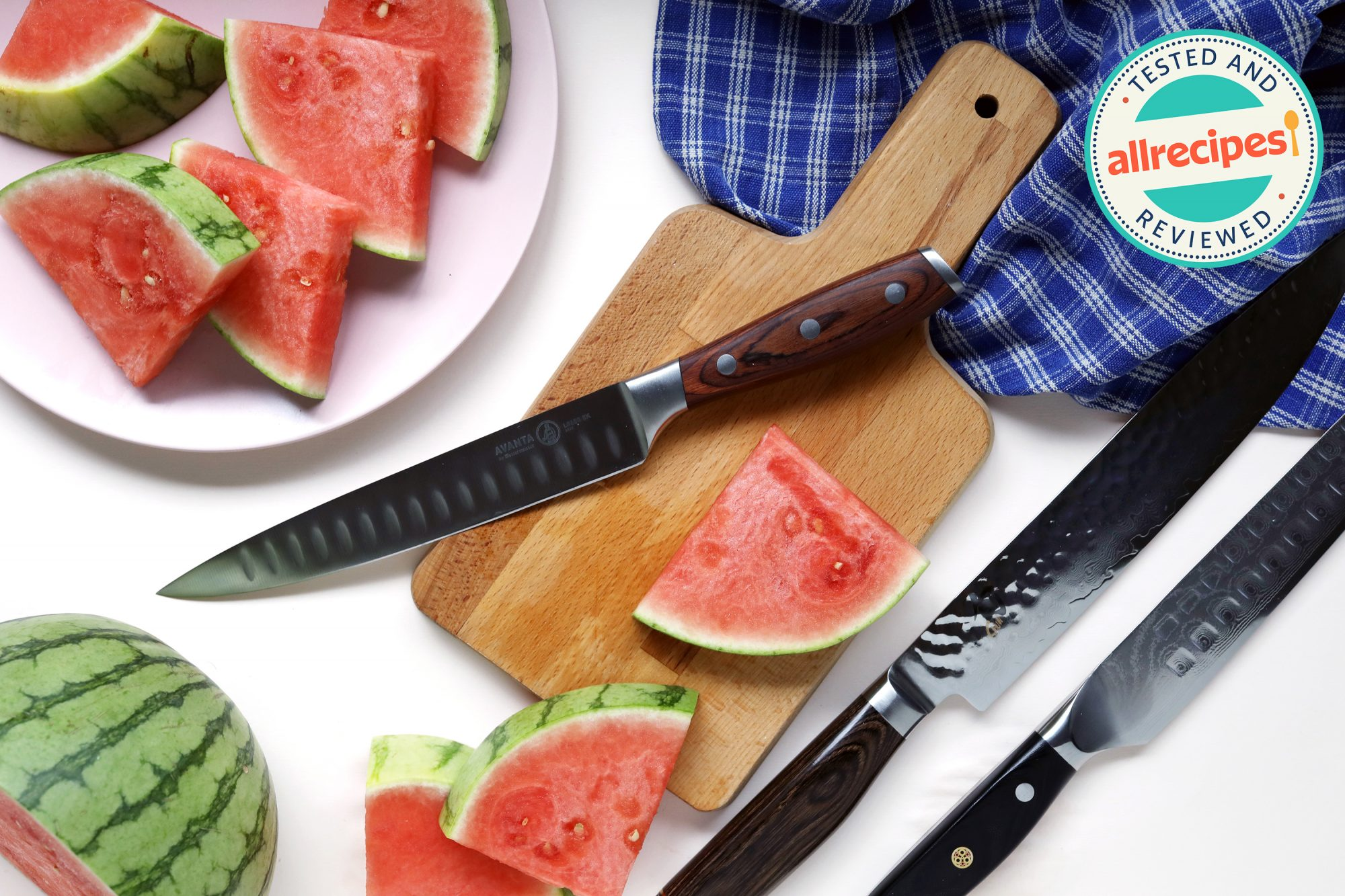 carving knives with cutting board and watermelon wedges