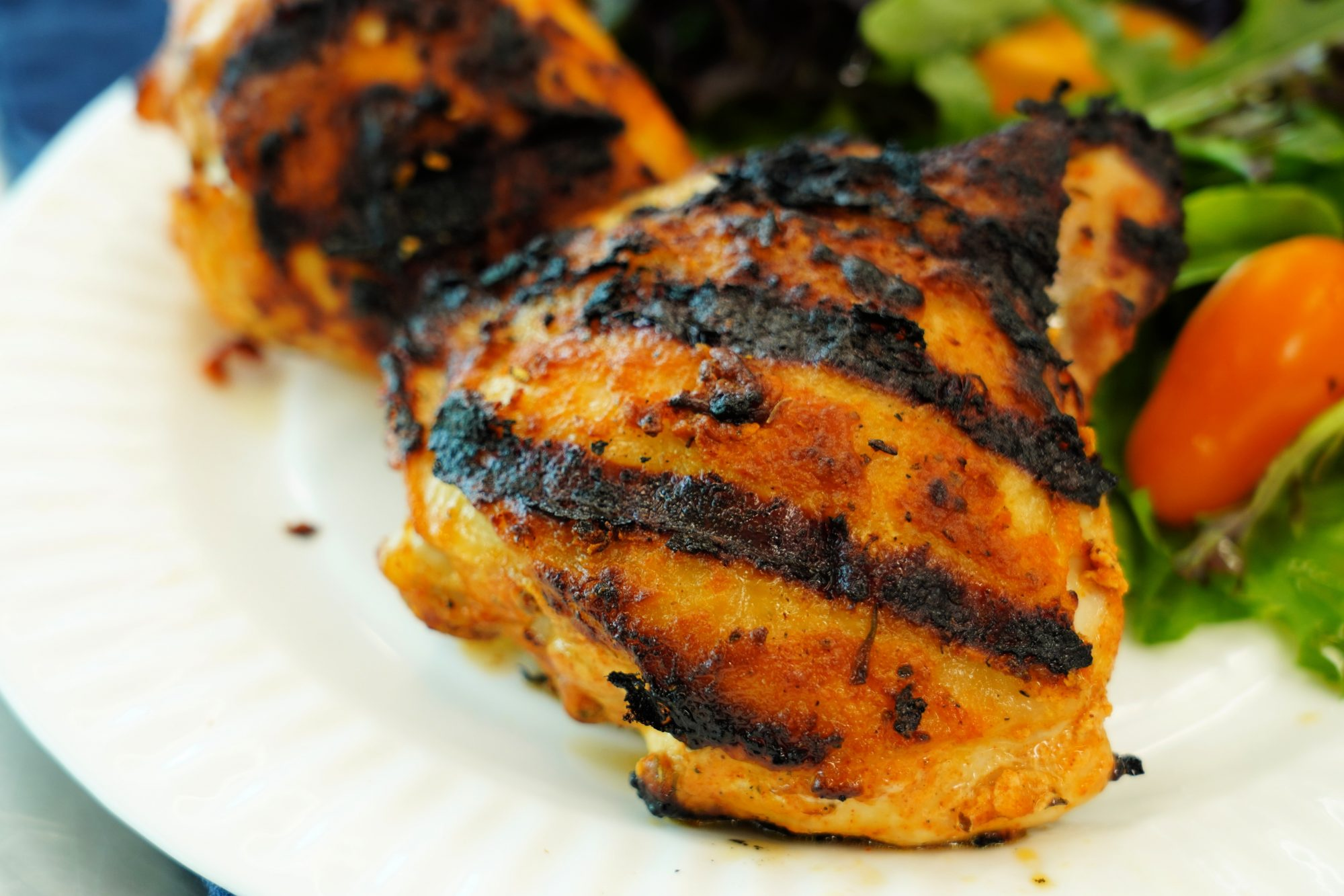 Grilled Lemon Yogurt Chicken served with green salad and tomatoes