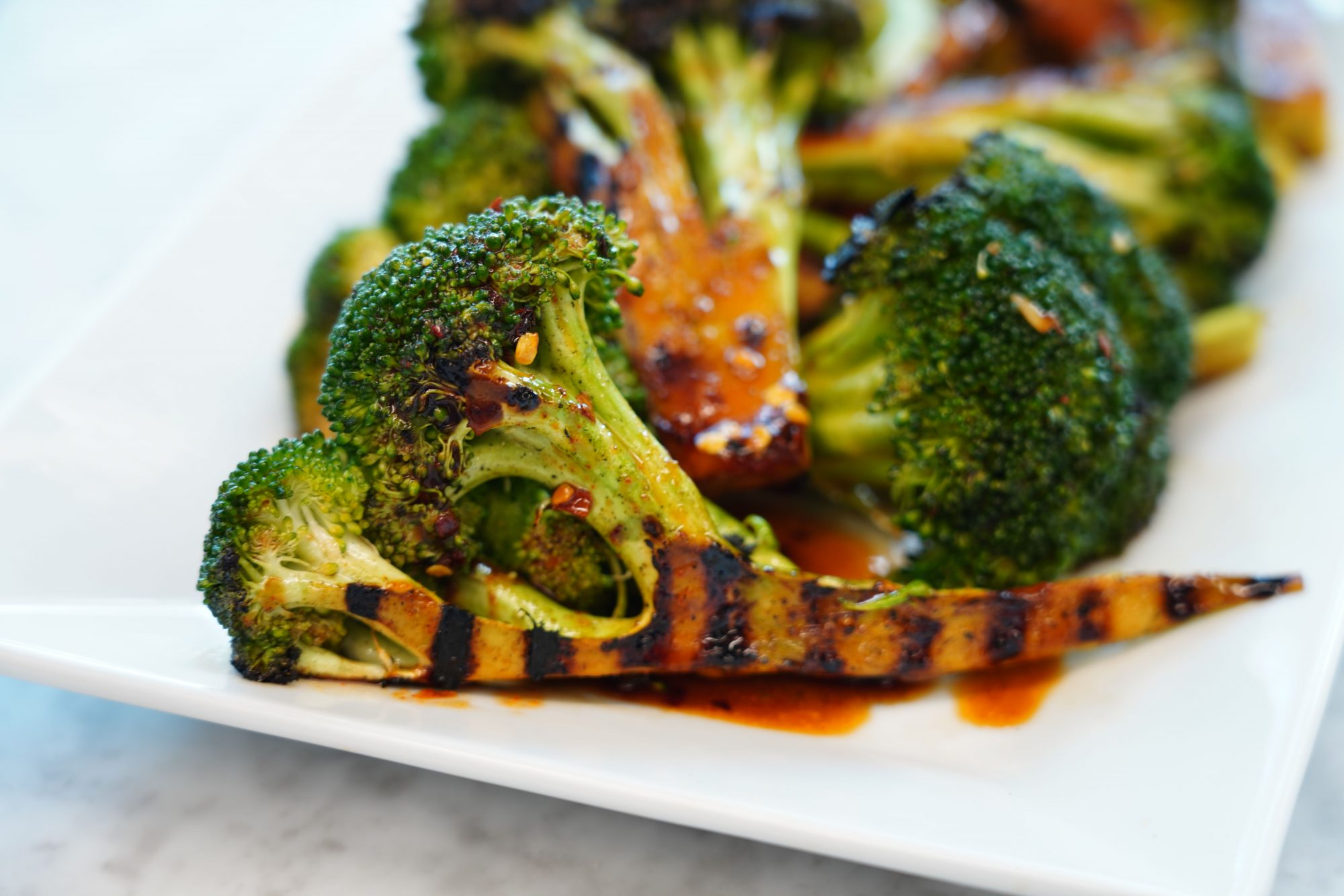 plate of Spicy Grilled Broccoli recipe with gochujang Korean hot pepper paste sauce