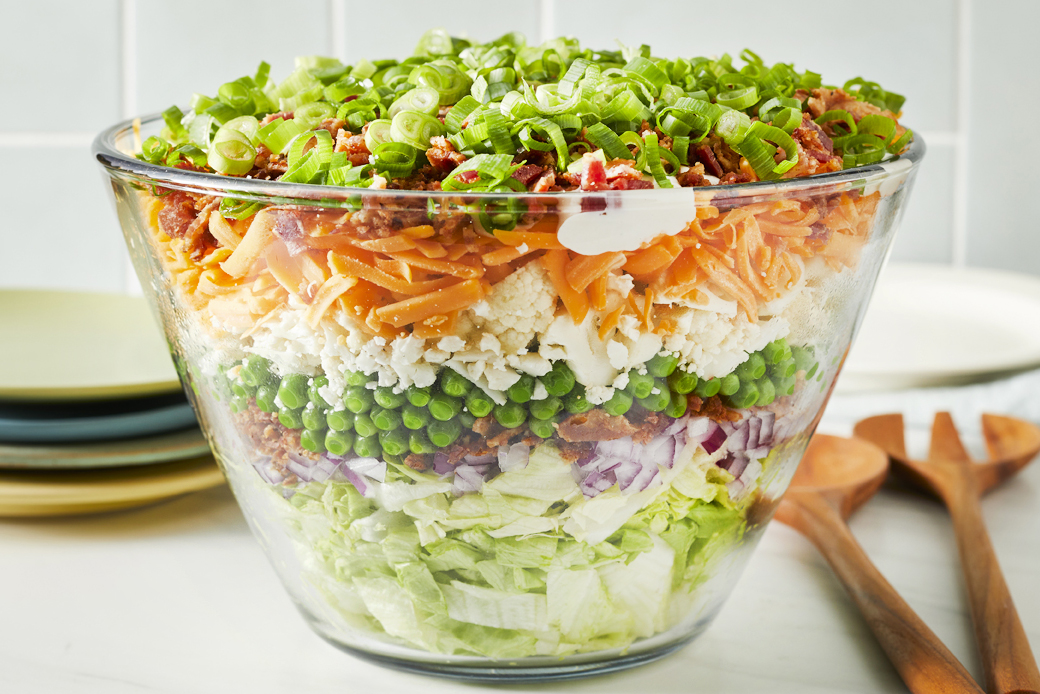 Seven layer salad in a clear trifle dish so all layers are visable.