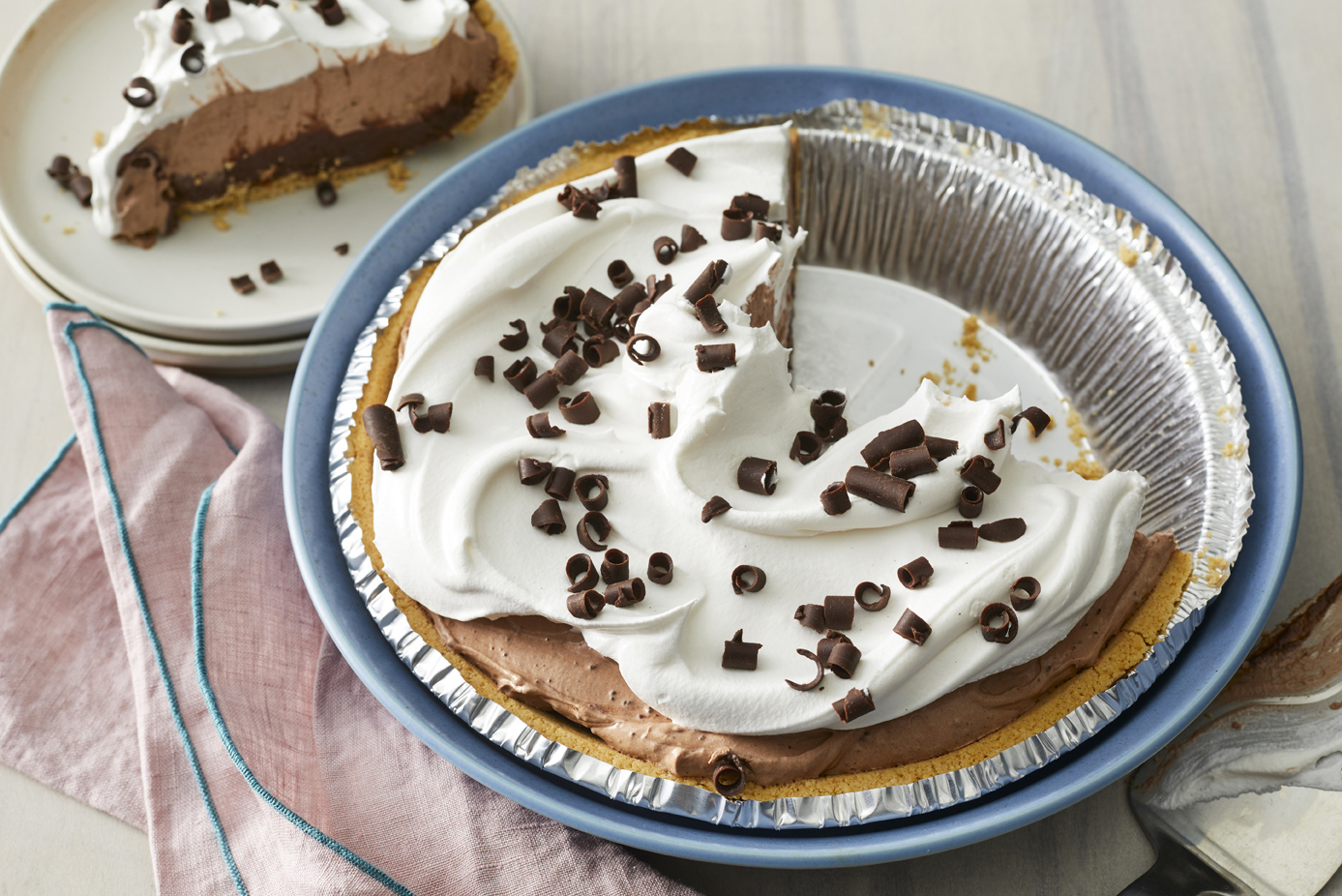 Krissy's Easy Chocolate Triple Layer Pie. A slice is out and plated in the background.