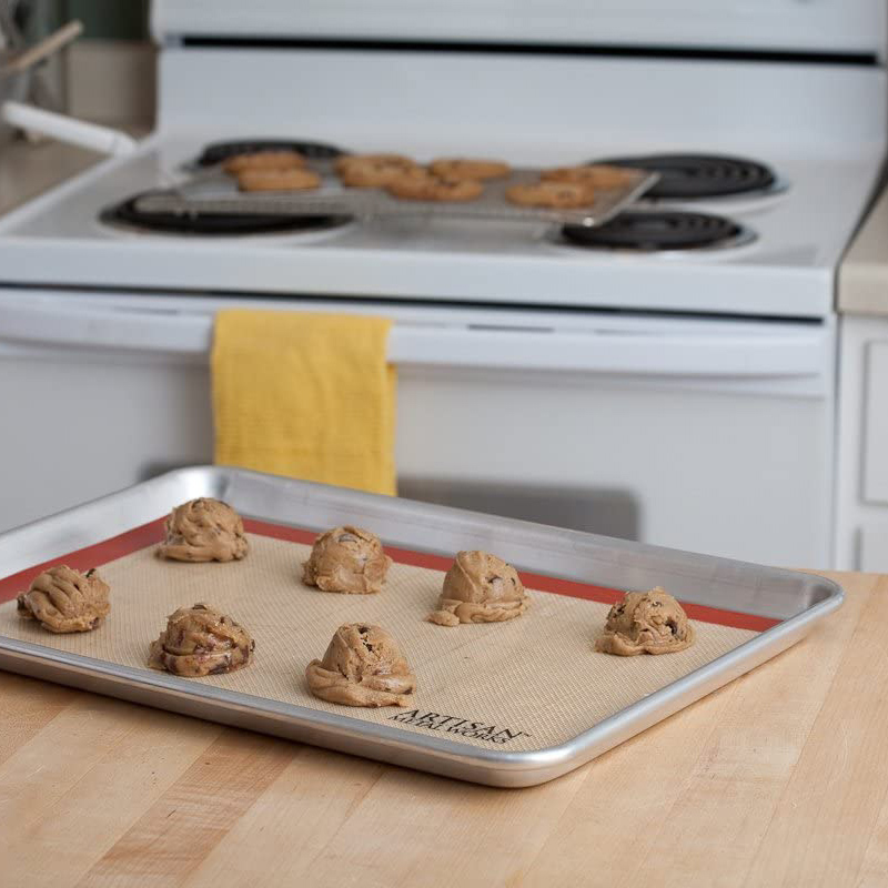 cookie dough on baking sheet with silicone mat