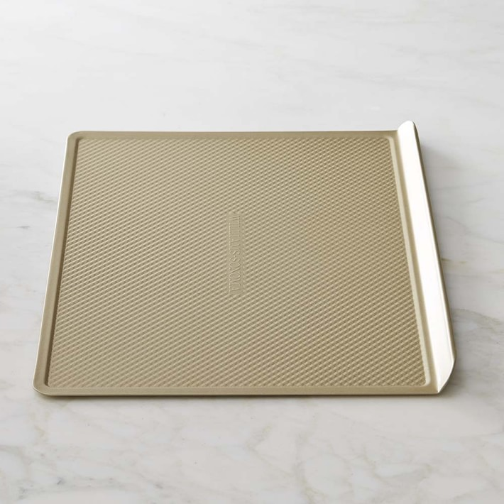 gold cookie sheet on marble countertop