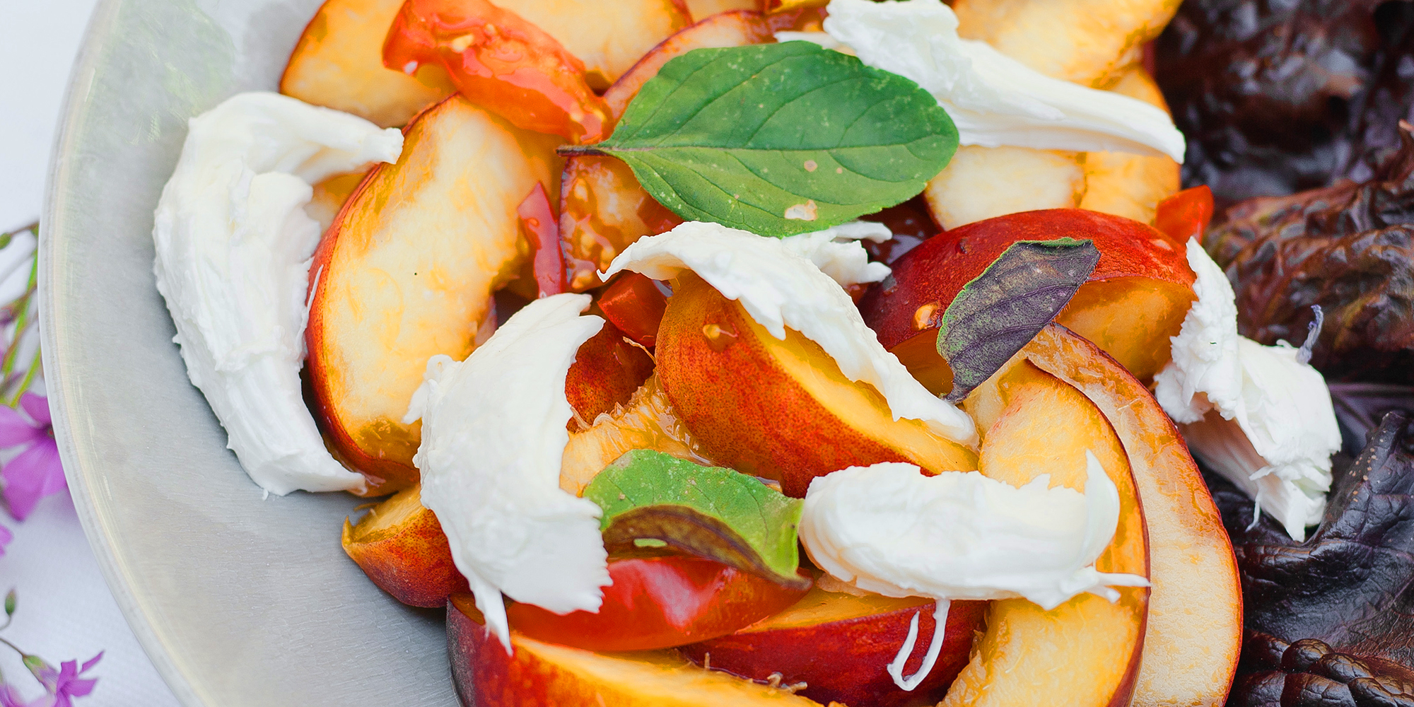 Summer salad with burrata, tomatoes, and nectarines