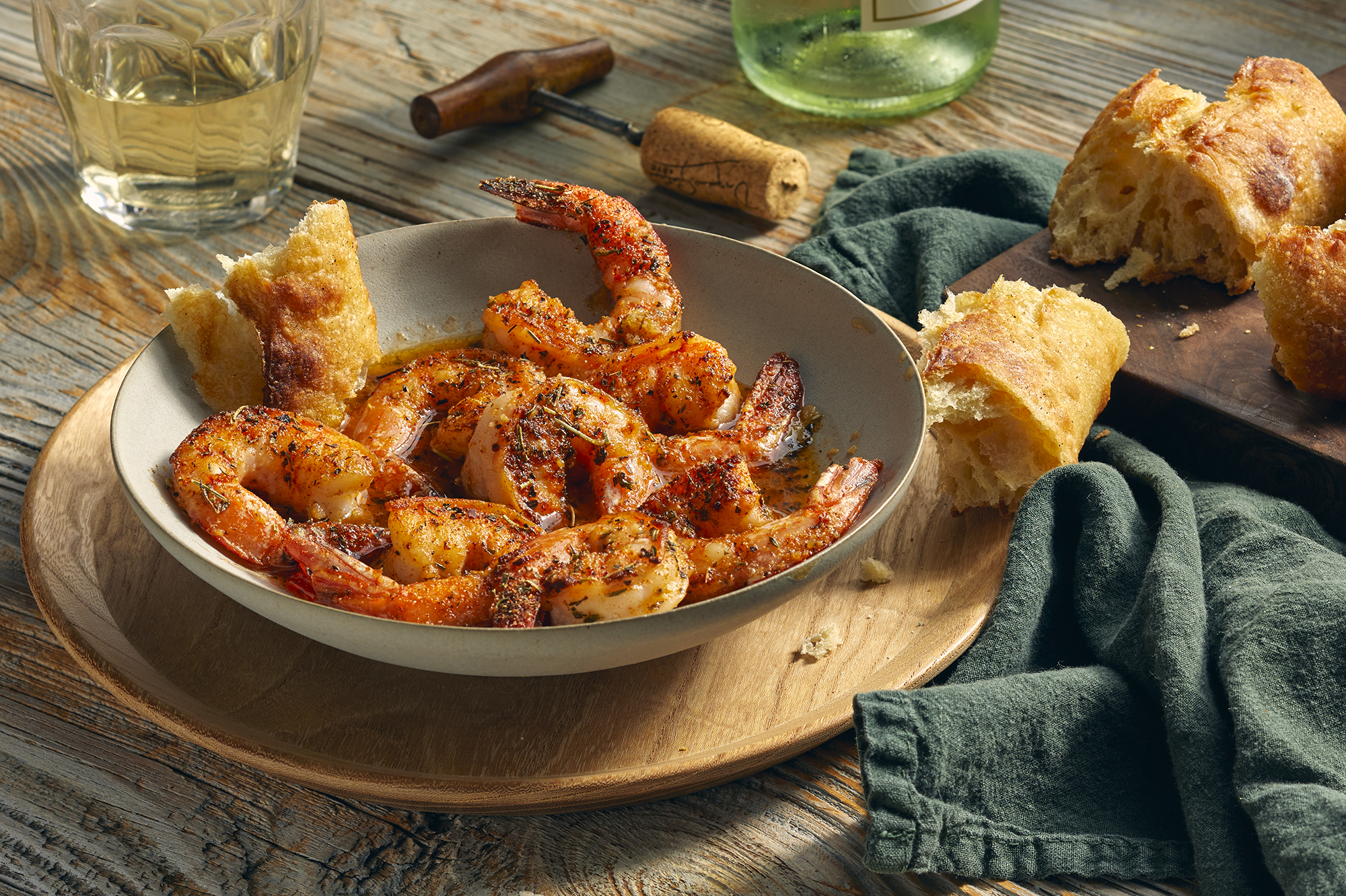 New Orleans barbecue shrimp served with crusty bread and white wine