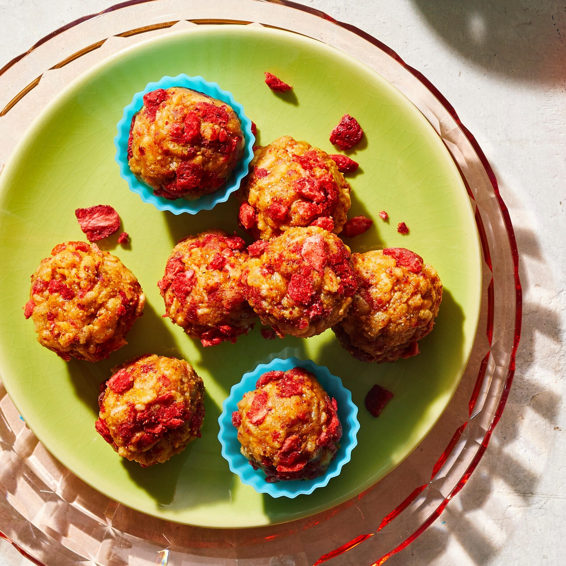 homemade Energy Balls rolled in crushed freeze-dried strawberries to make PB&J bites