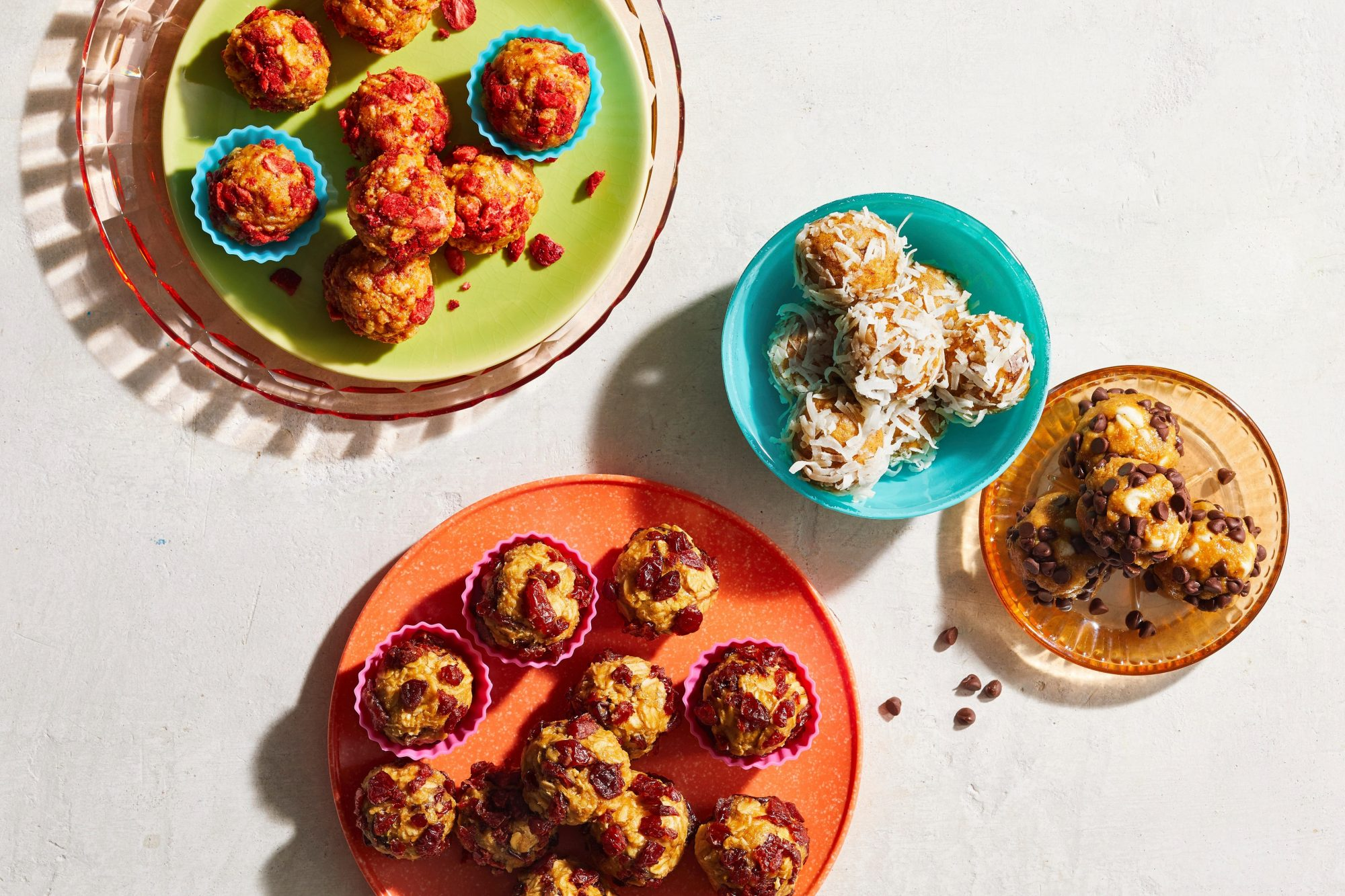 overhead view of four different kinds of homemade energy balls
