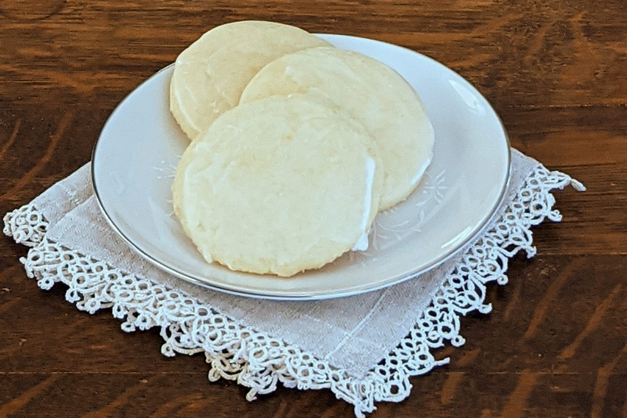 Great-Grandma's Sour Cream Drop Cookies baked as glazed cut-out sugar cookies