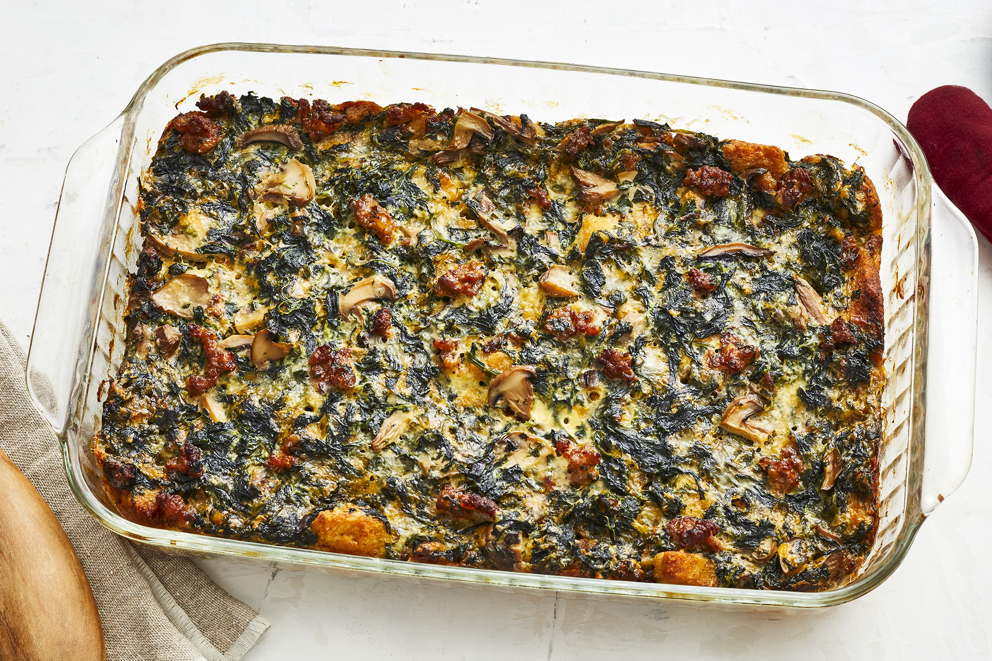 overhead view of a make ahead breakfast casserole in a clear 9x13 baking dish