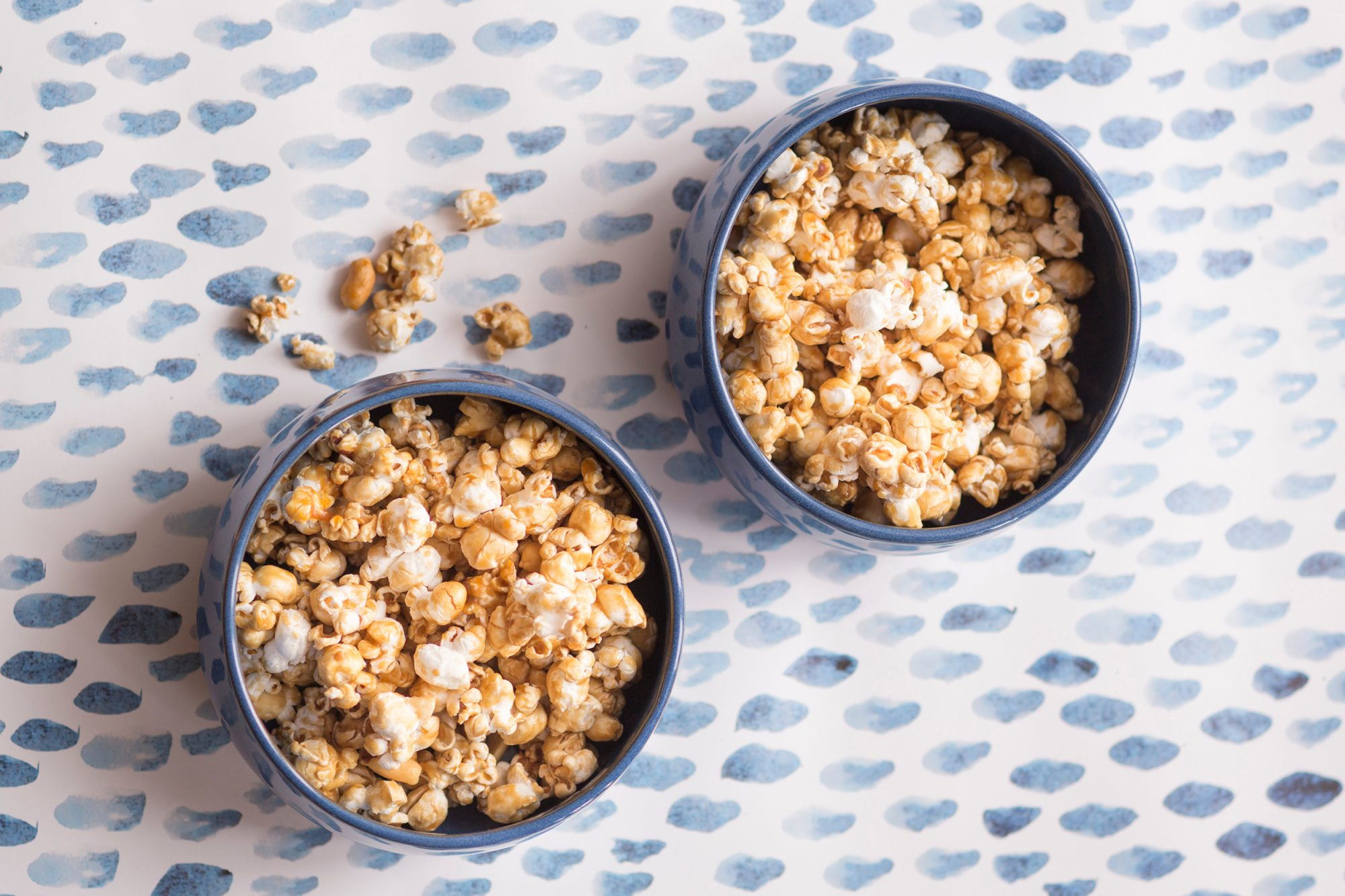 sweet popcorn in bowls on a blue patterned background
