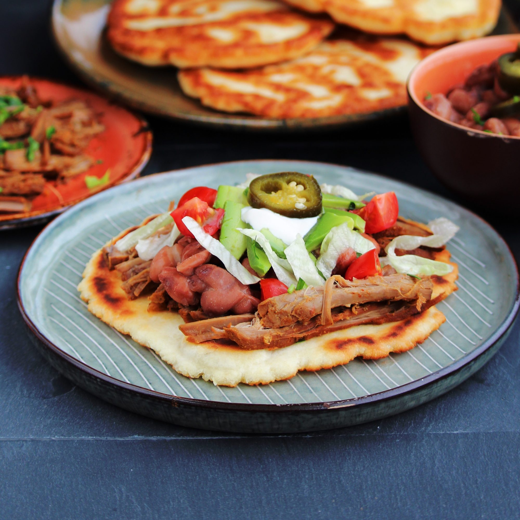 shredded beef with beans and jalapeno on fry bread