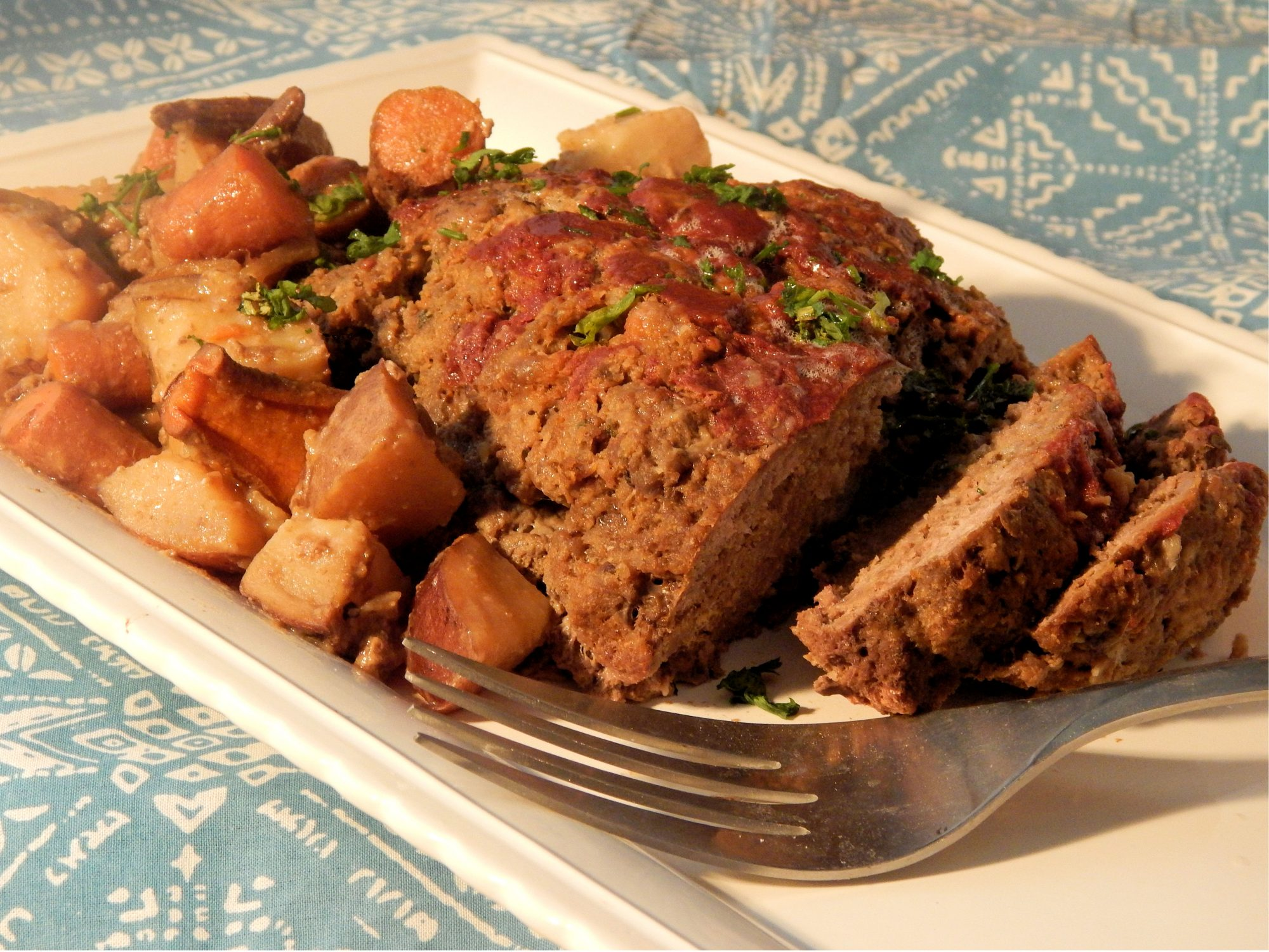 """Forget dry and flavorless meat loaf; the slow cooker seals in flavor and moisture. We love that this recipe cooks the potatoes and carrots alongside the meat: """"Came out delicious and the veggies being cooked with the meat I think was my favorite part…"""" says reviewer and"""