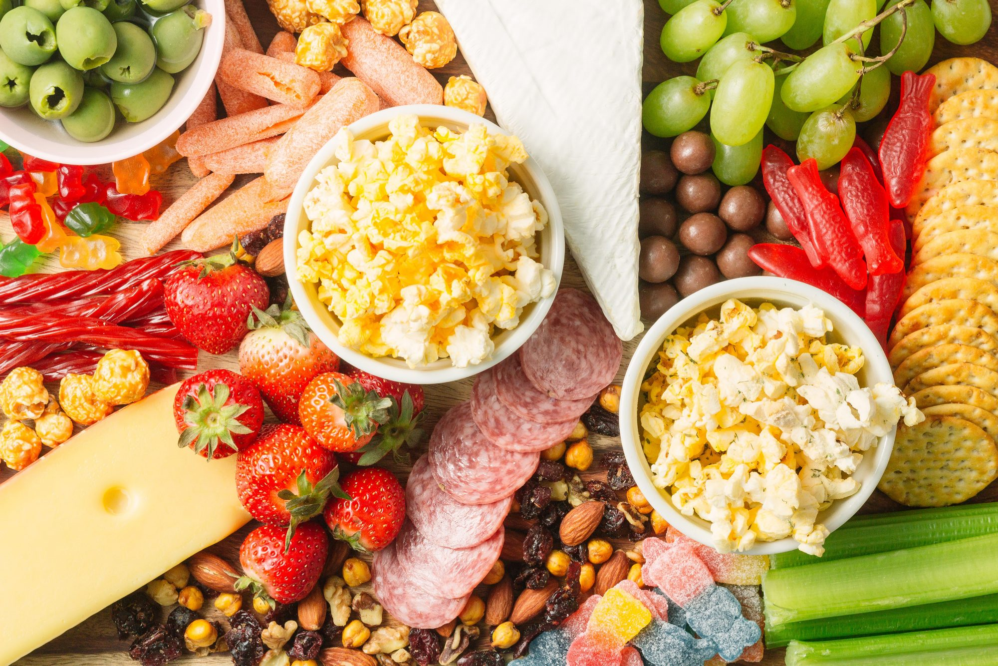 grown-up snack board with popcorn and candy