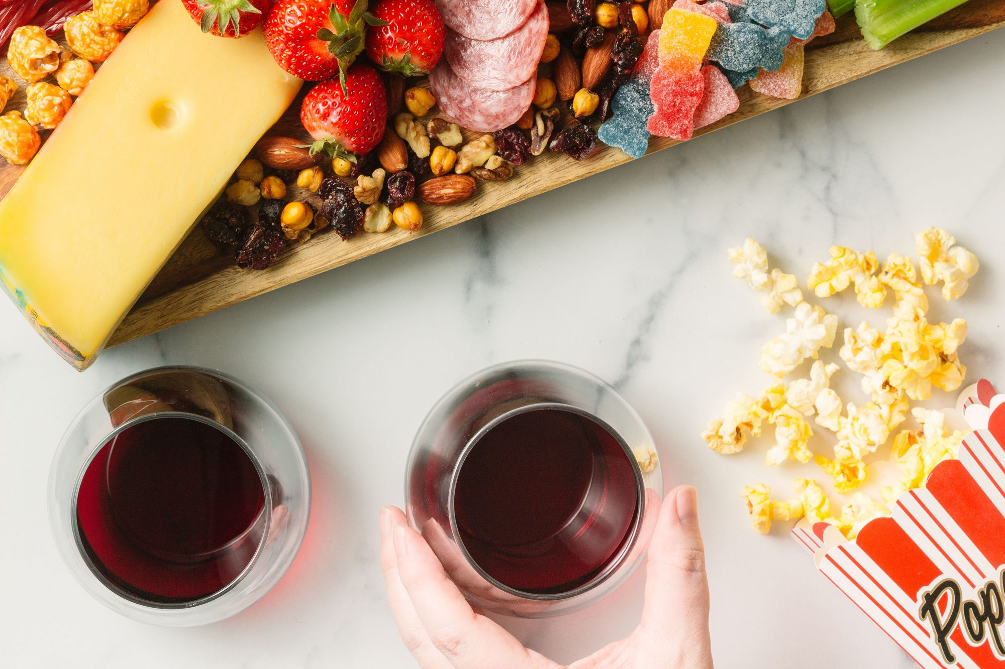 grown-up snacking board with popcorn and wine