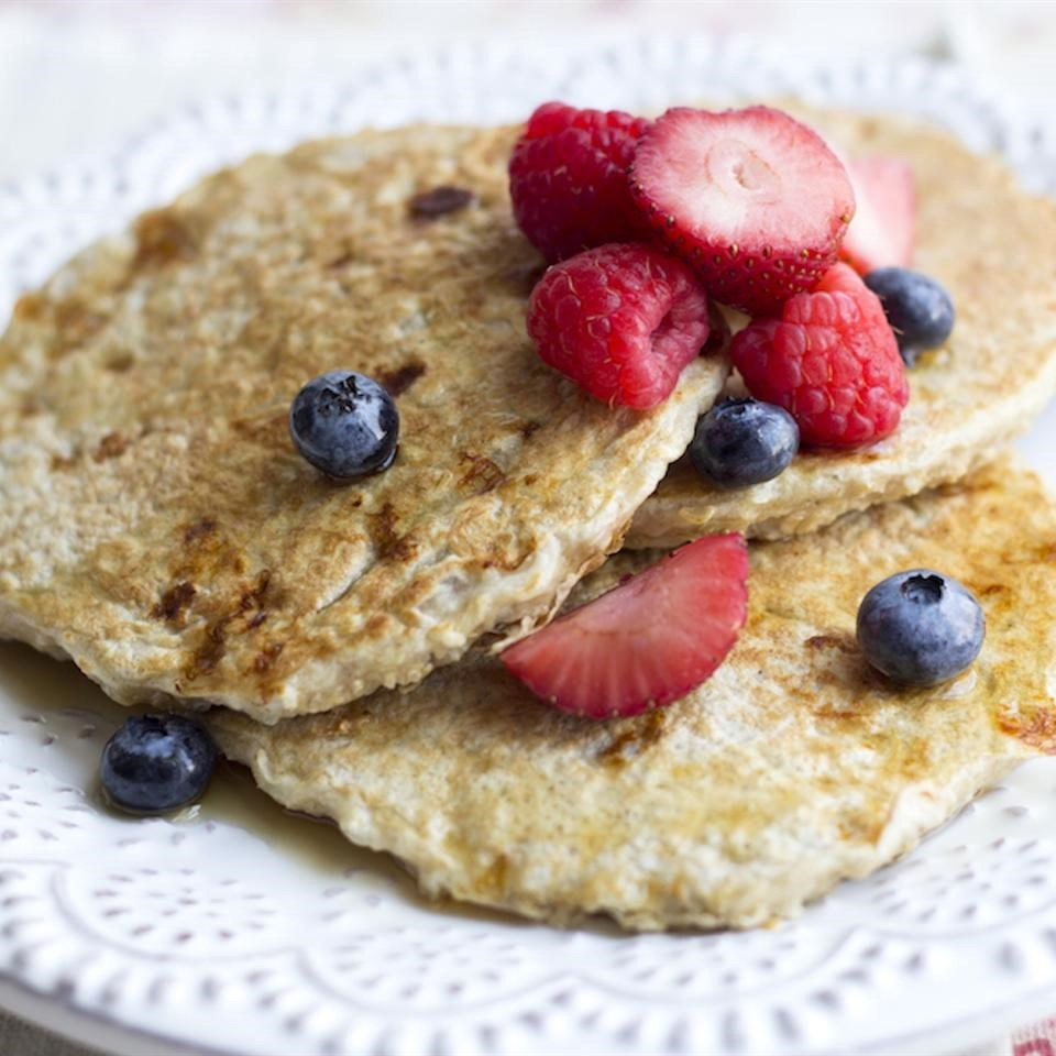 pancakes with berries on a white doily
