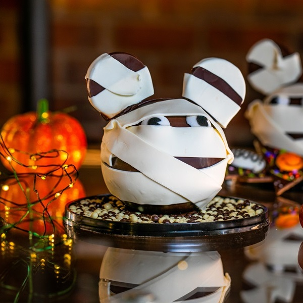 Chocolate bomb decorated to look like a Micky Mouse mummy head to create a Disney Halloween treat
