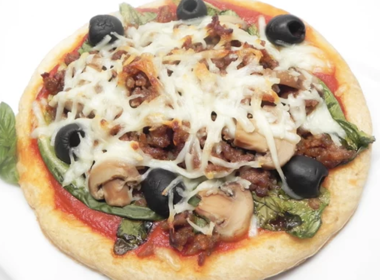 A store-bought pizza crust is topped with pizza sauce, garlic, escarole, and mozzarella. If you have them on hand, add mushrooms and black olives for more flavor.