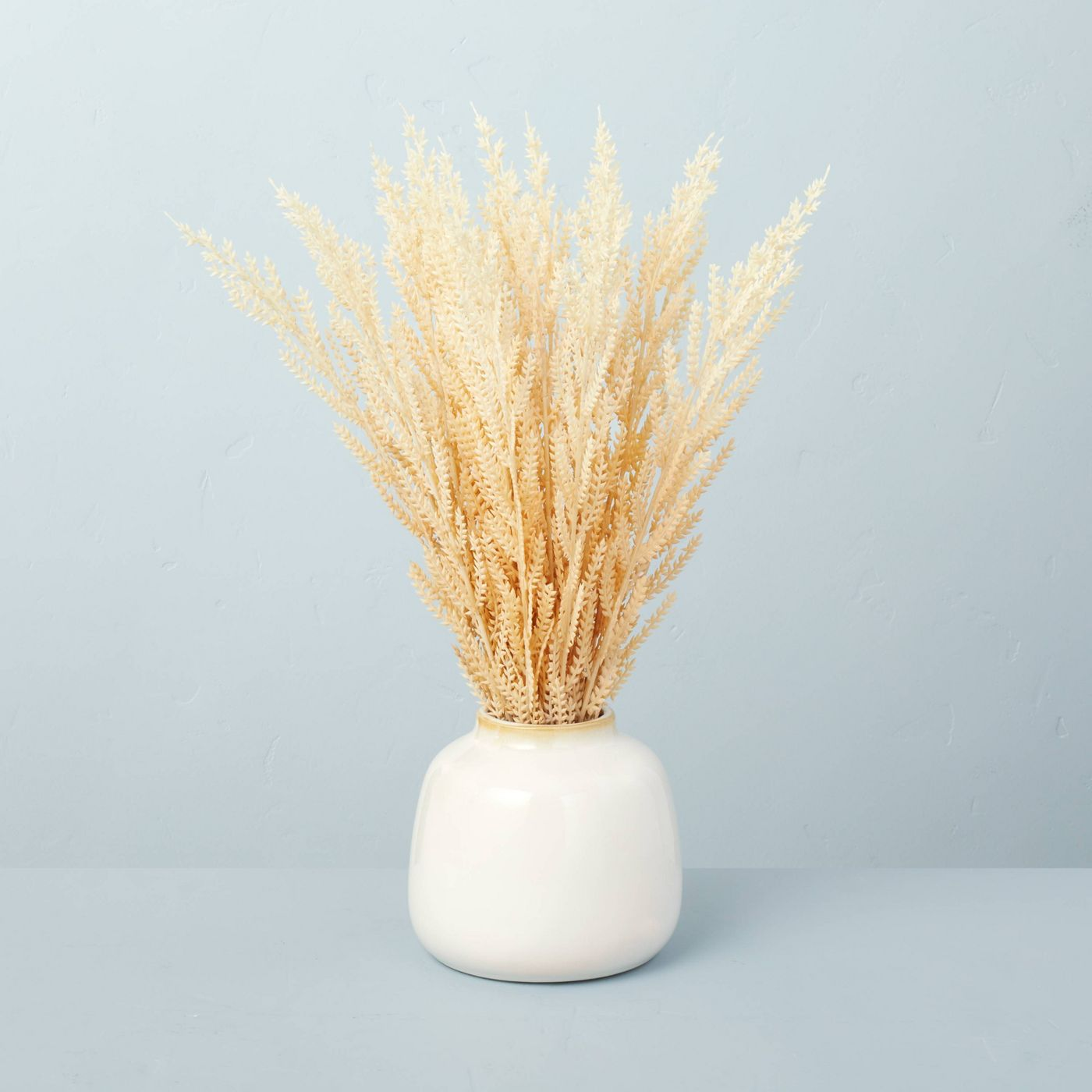 white vase with faux wheat grass