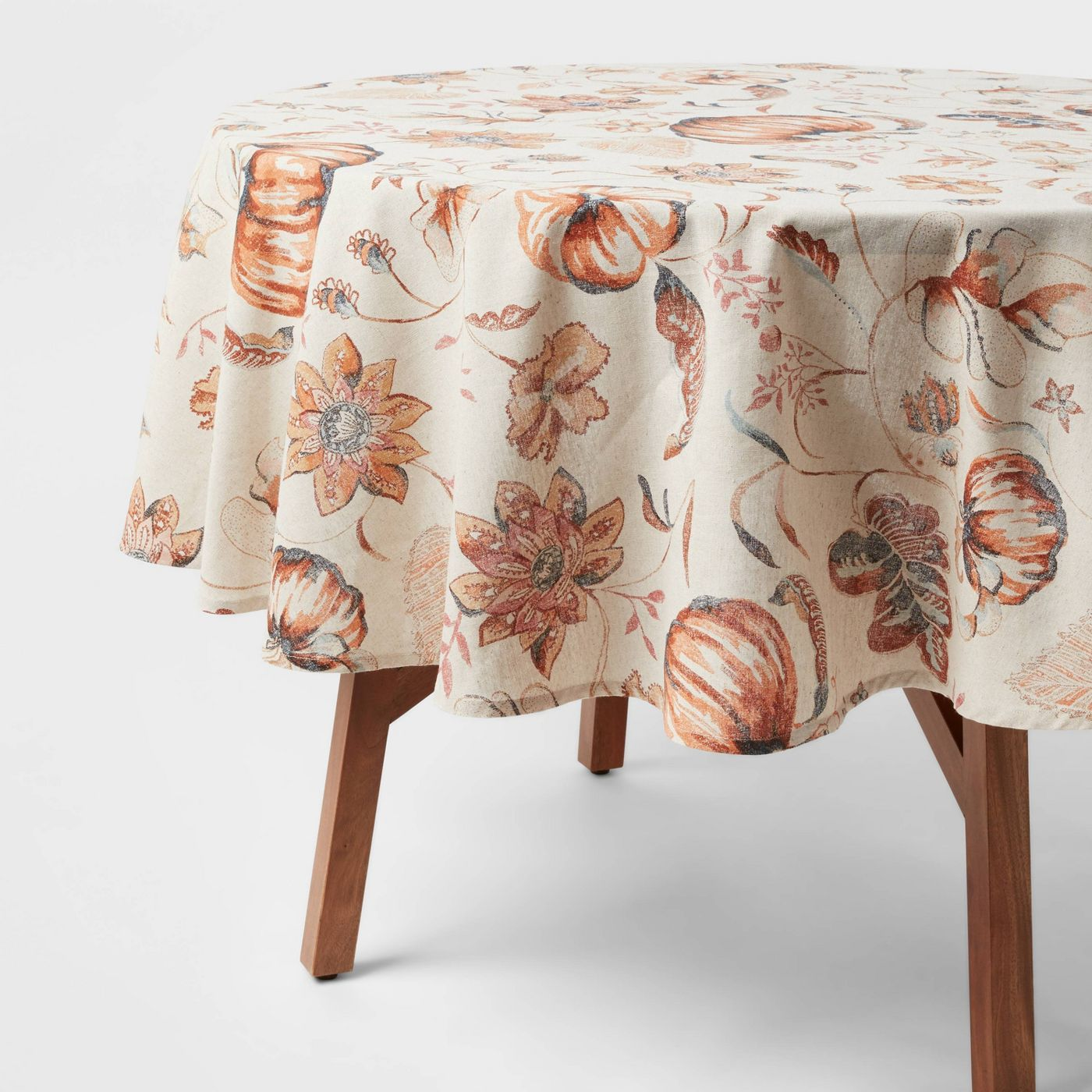 off white tablecloth with pumpkin and leaf watercolor motif