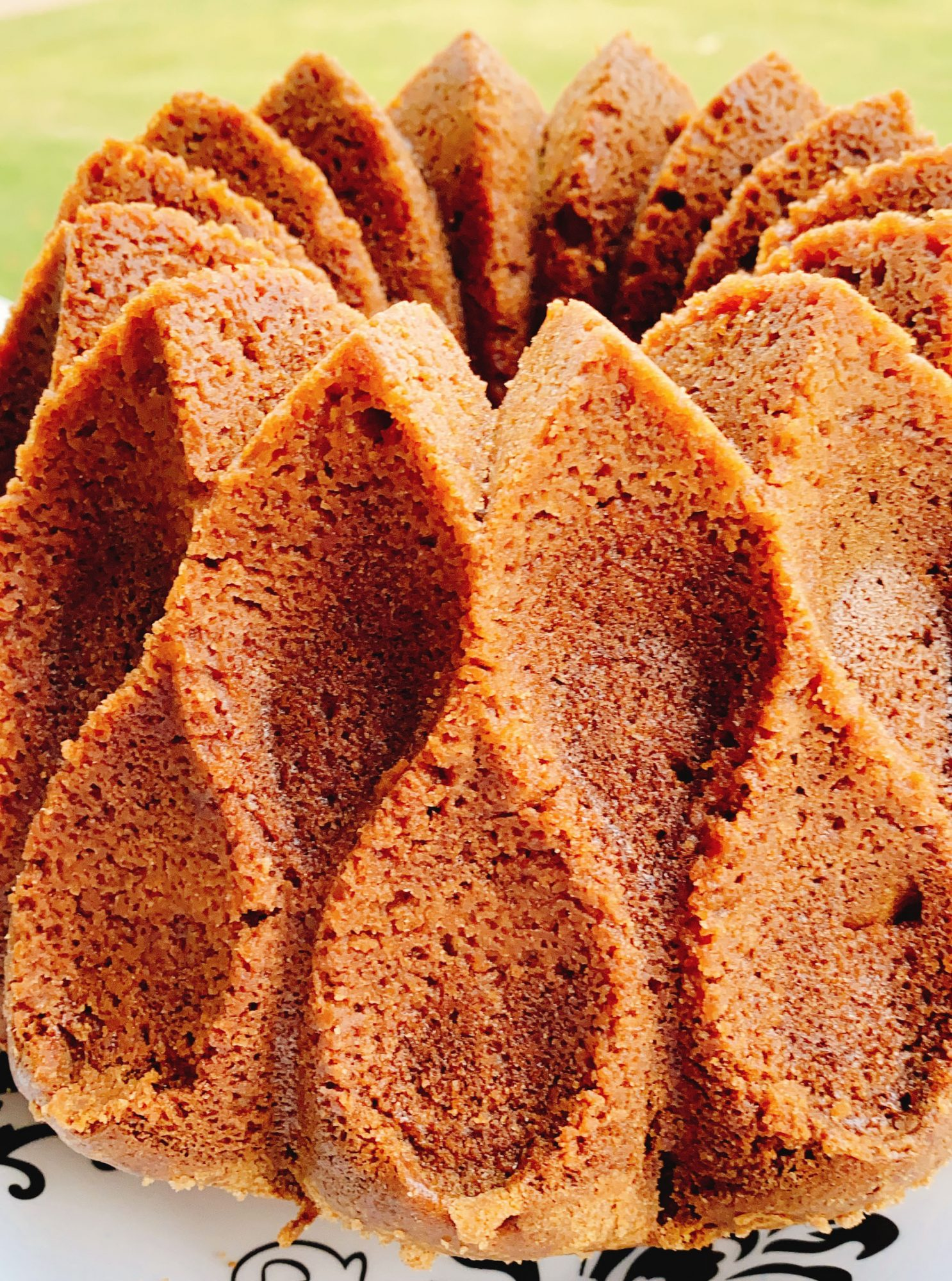 closeup of a cake baked in a decorative tube pan