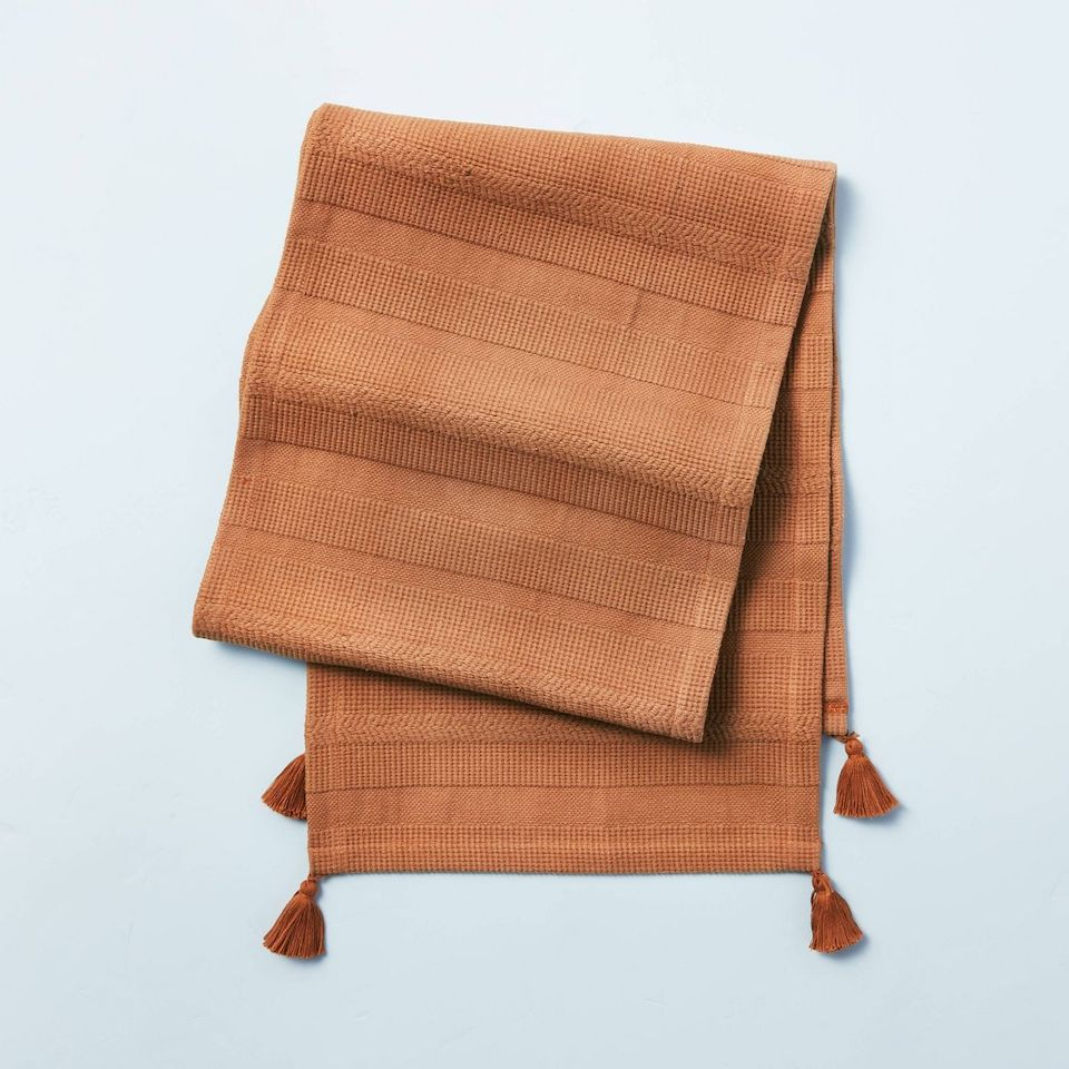 pumpkin colored table runner with fringe