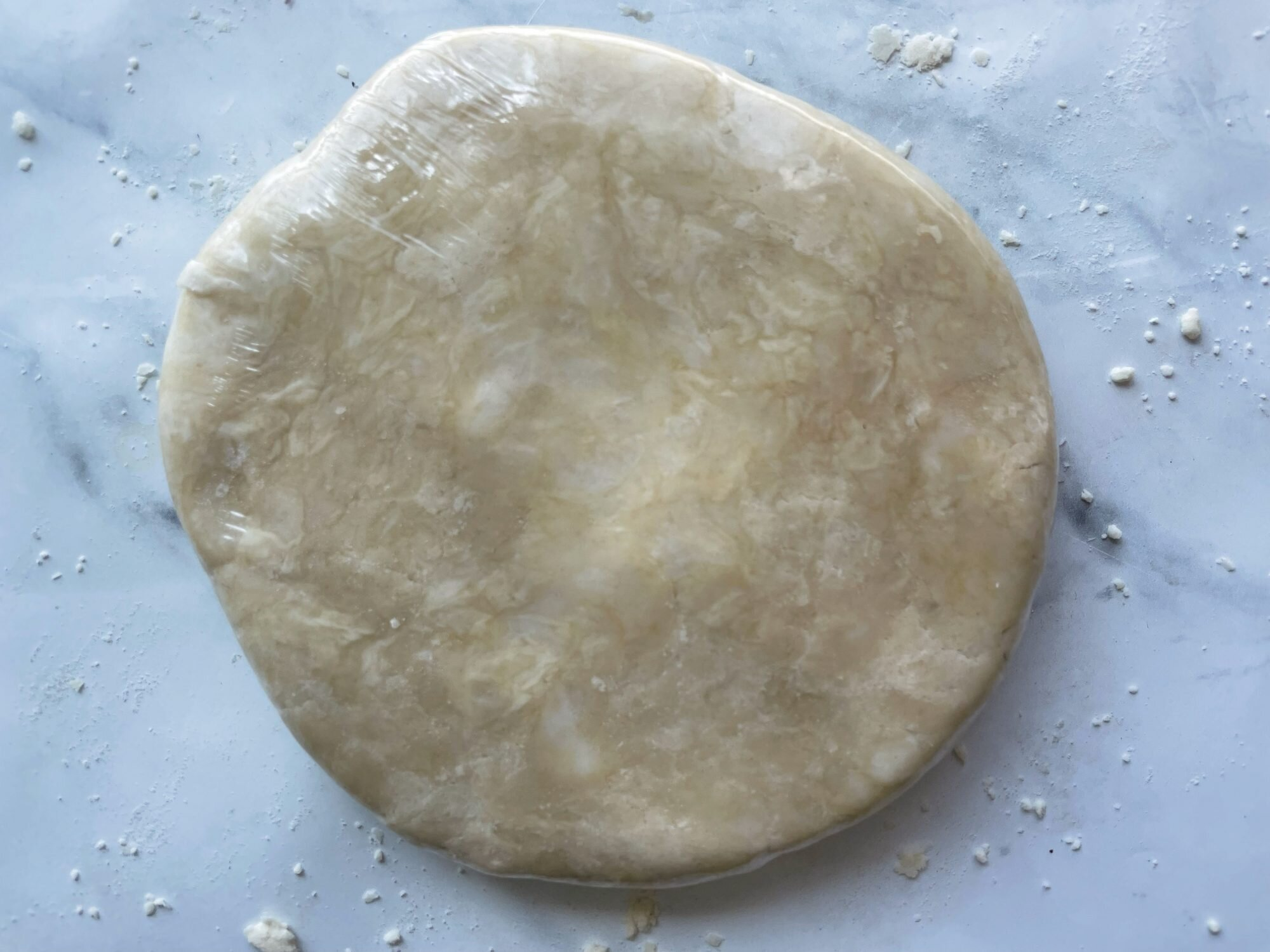 pie dough wrapped in plastic