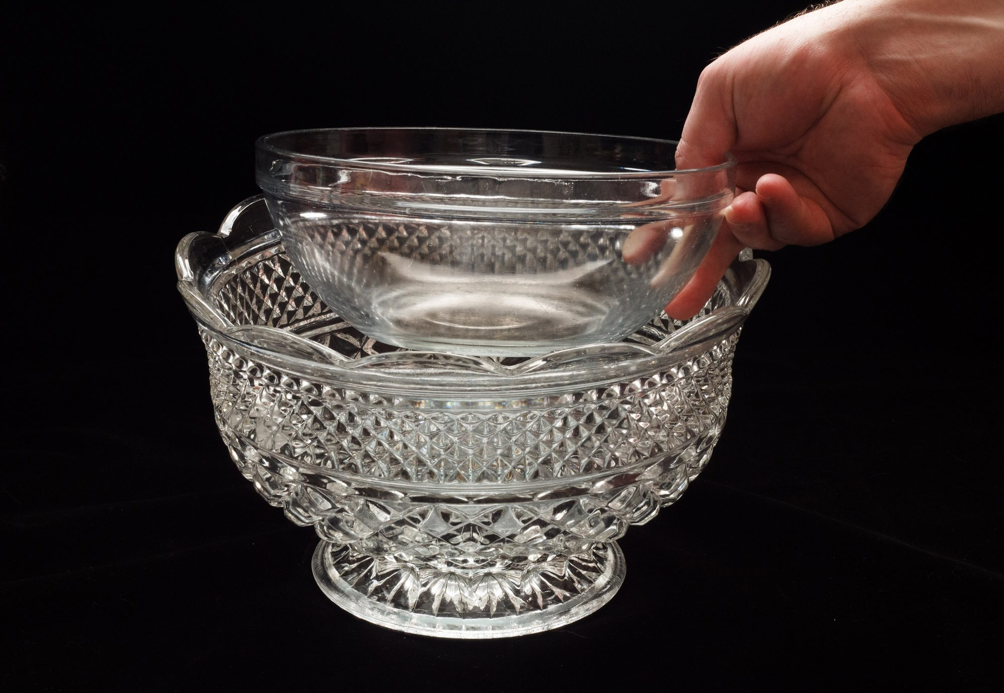 Placing a medium glass bowl inside a large glass punch bowl