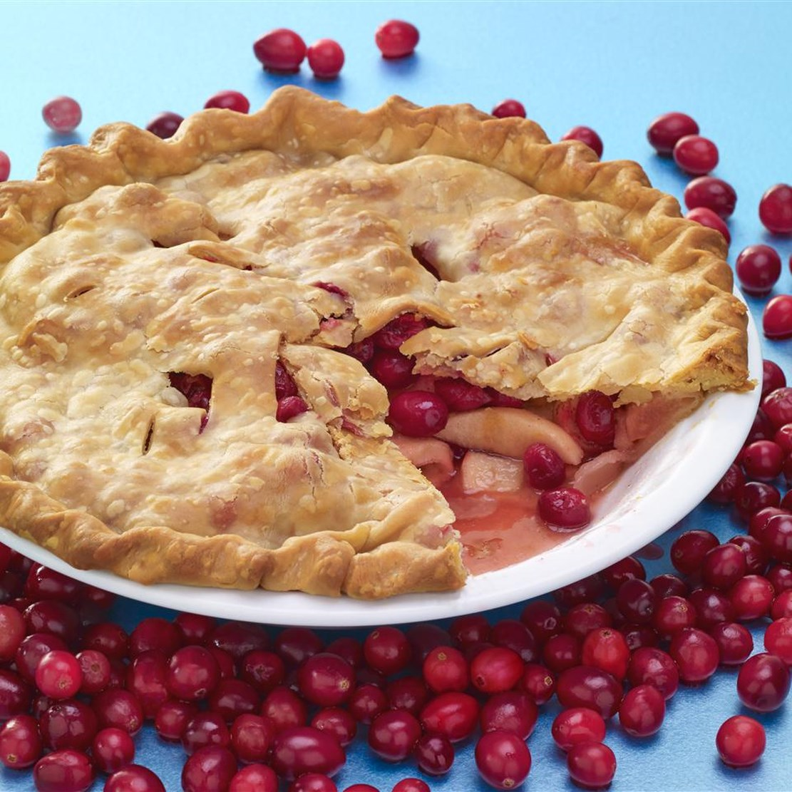 apple cranberry pie with a slice taken out