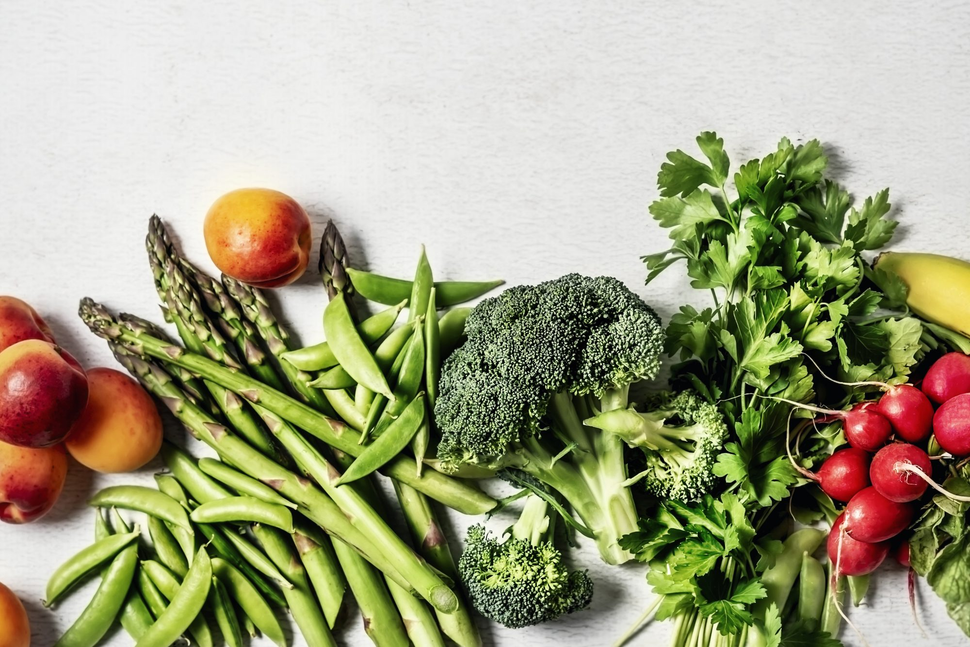Fresh vegetables and fruits on white background
