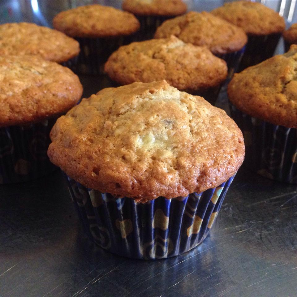 golden brown muffins baked in blue cupcake papers