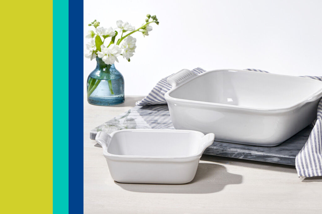 two white square baking dishes on a marble counter