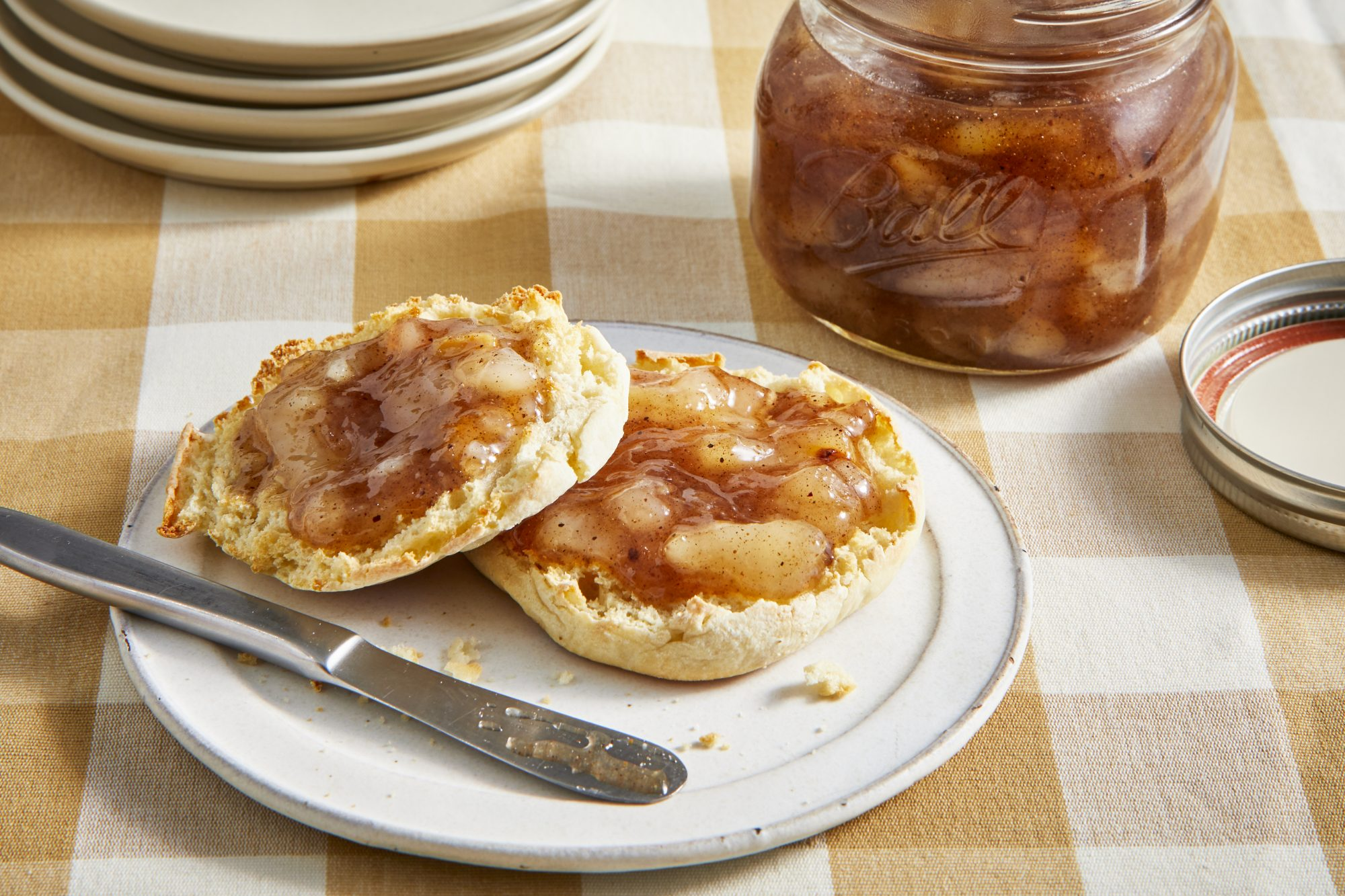 into view on a slice and toasted english muffin topped with grandma's pear preserves.