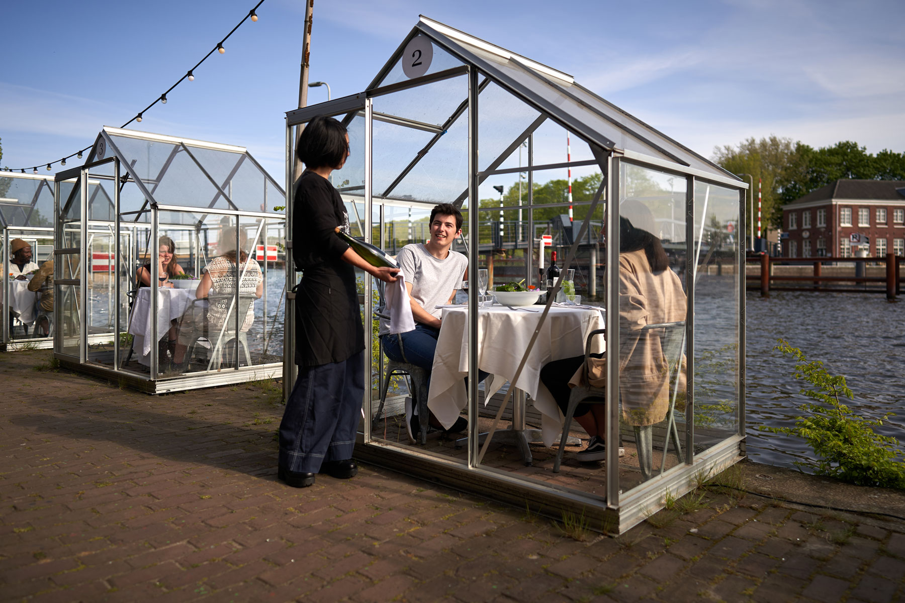 water side dining 'greenhouse' in Amsterdam