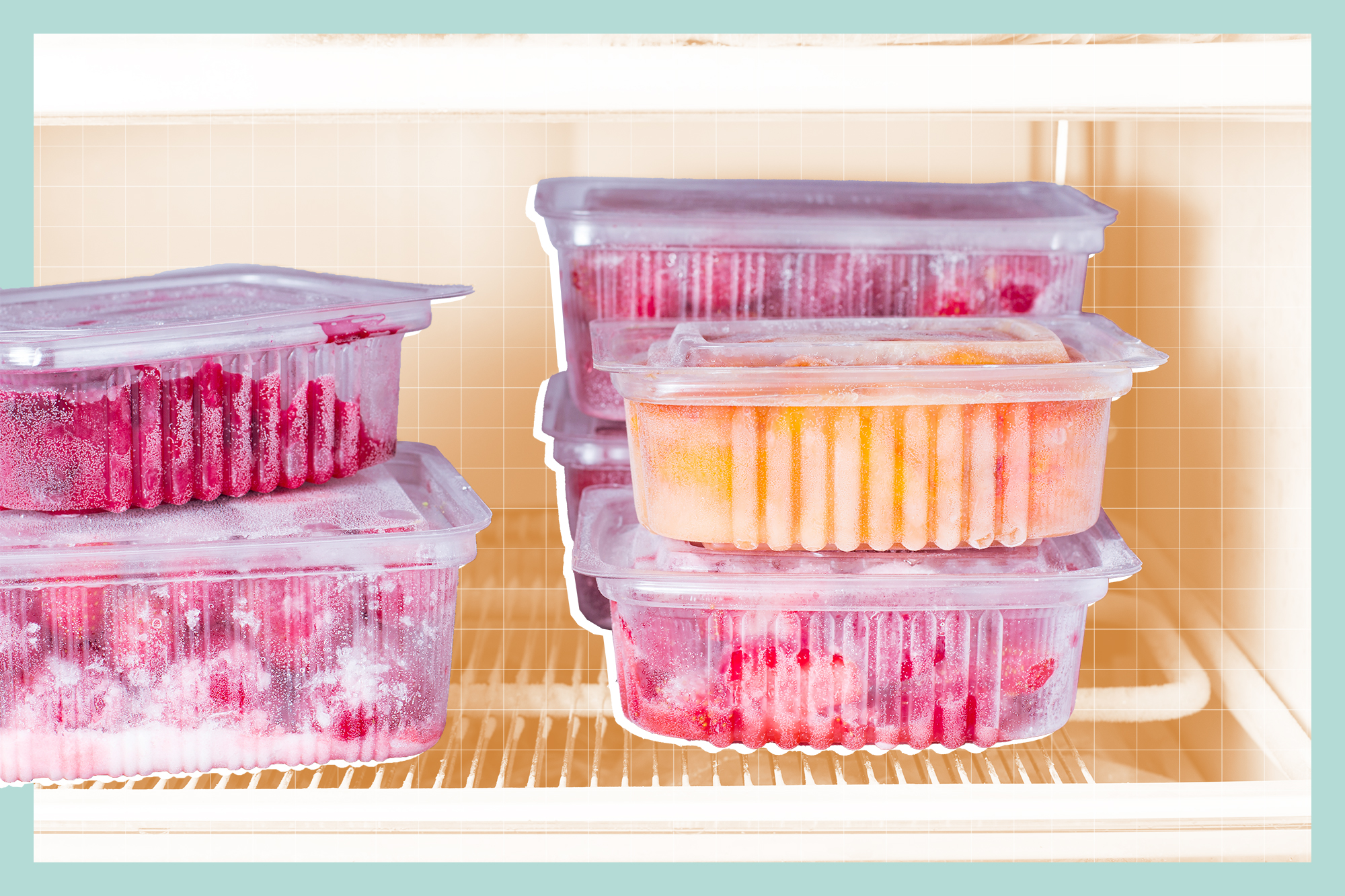 Frozen fruits and berries in a container in the freezer