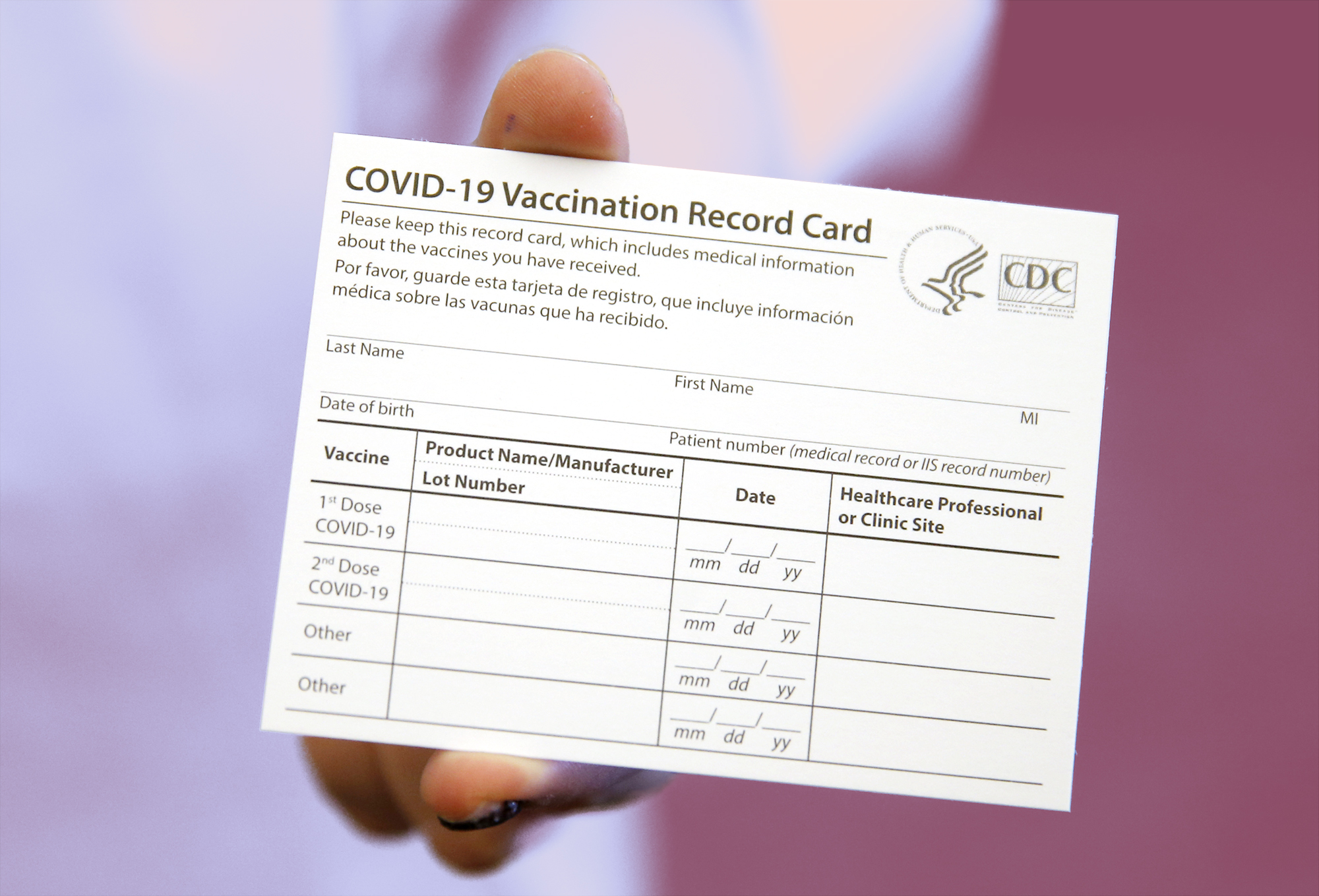 Your COVID-19 Vaccine Card, What to Do if You Lose It, Why You Shouldn't Laminate It, and Other Important Info , BOSTON - DECEMBER 16: Elizabeth Hafted, Pharmacist displays a COVID-19 Vaccination Record Card at Beth Israel Deaconess Medical Center in Boston on Dec. 16, 2020. (Photo by Jessica Rinaldi/The Boston Globe via Getty Images)