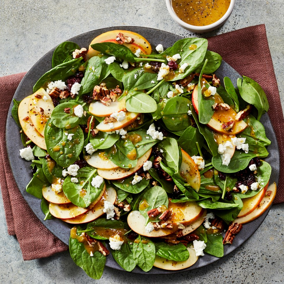 Apple-Cranberry Spinach Salad with Goat Cheese recipe on a plate