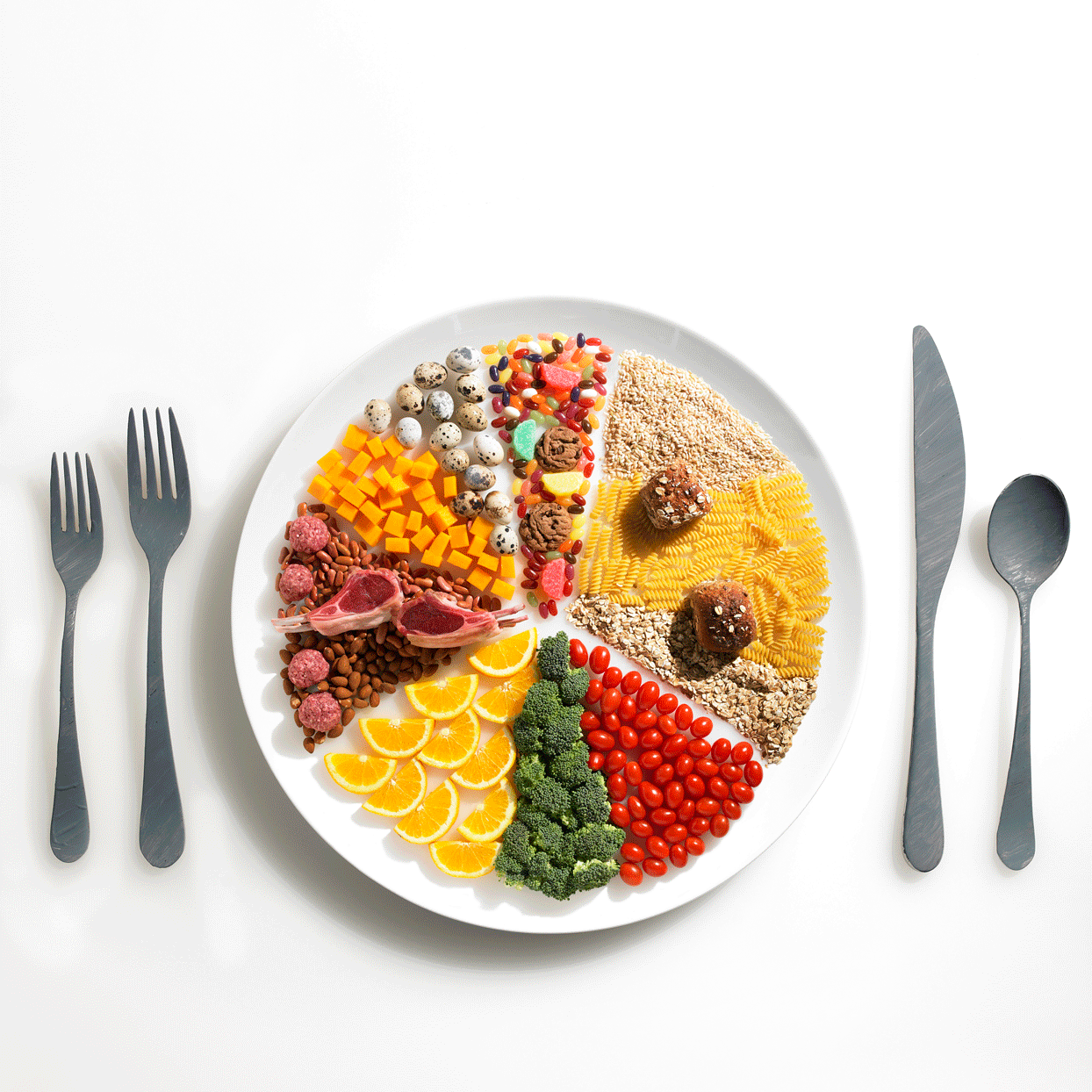 many different types of food organized neatly on a white plate