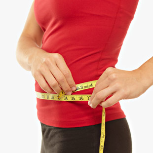 MCL_woman_measuring_tape_waist_101660467_scheidemann_3.jpg