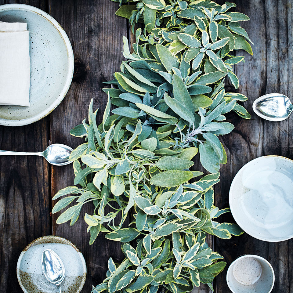 sage garland on a table