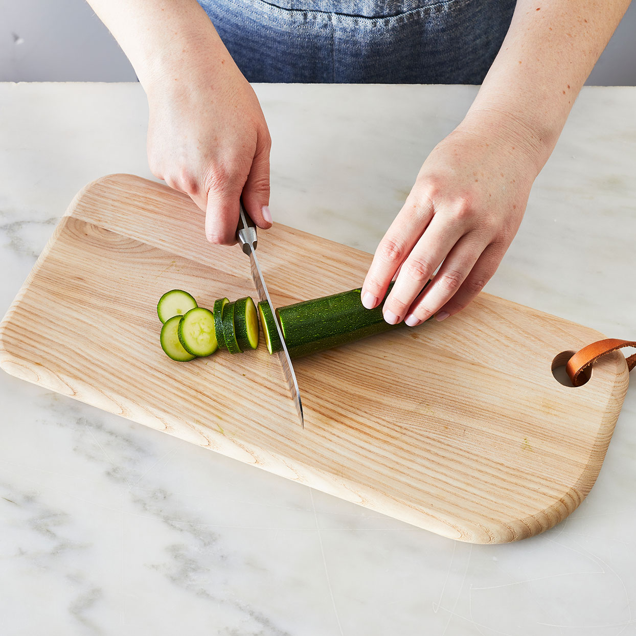 Slicing-zucchini-to-saute