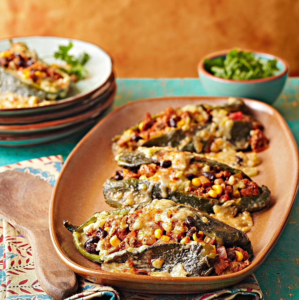 Corn and Chorizo Stuffed Poblanos with Green Chile-Cheese Sauce