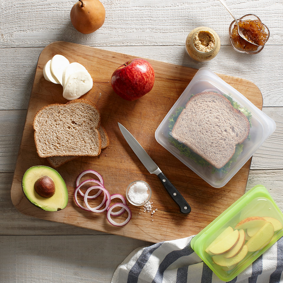 making sandwiches on a cutting board with Stasher sandwich bags
