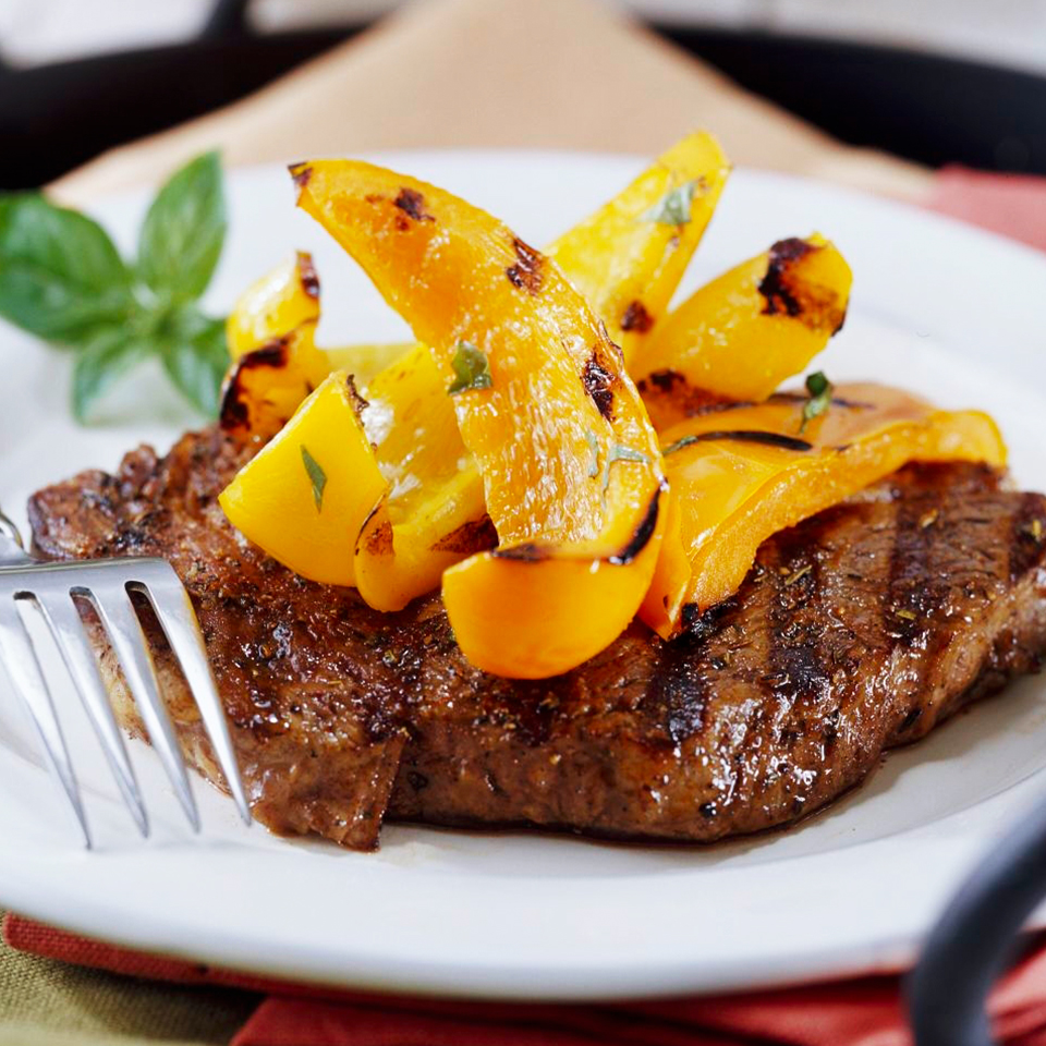 Peppered Ribeye Steaks with Grilled Sweet Peppers